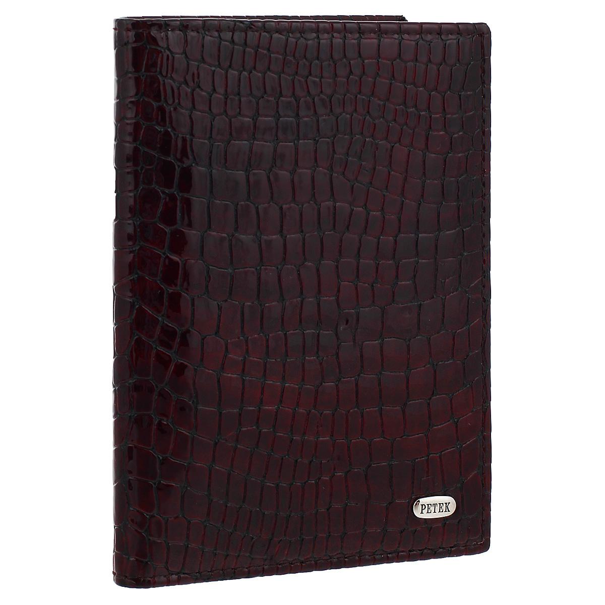 Обложка на автодокументы Burgundy, цвет: баклажан. 584.091.03SC-FD421005Обложка на автодокументы Burgundy, выполненная из натуральной лаковой кожи, не только поможет сохранить внешний вид ваших документов и защитит их от повреждений, но и станет стильным аксессуаром, идеально подходящим вашему образу. Внутри четыре прорезных кармана для кредитных карт, удобный блок для водительских документов из прозрачного пластика и пять карманов для бумаг из прозрачного пластика.Такая обложка станет замечательным подарком человеку, ценящему качественные и практичные вещи. Характеристики:Материал: натуральная кожа, пластик. Размер обложки: 9 см х 12,5 см х 1 см. Цвет: баклажан.