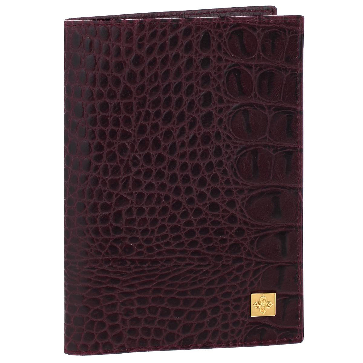 """Обложка для паспорта женская Dimanche Sangria, цвет: бордовый. 710BP-001 BKСтильная обложка Sangria выполнена из натуральной кожи с фактурным тиснением """"под крокодила"""". На внутреннем развороте расположено два вертикальных кармана из прозрачного пластика. Такая обложка не только поможет сохранить внешний вид ваших документов и защитит их от повреждений, но и станет ярким аксессуаром, который подчеркнет ваш образ. Обложка упакована в подарочную картонную коробку с логотипом фирмы. Характеристики:Материал: натуральная кожа, ПВХ. Размер обложки: 9,5 см х 13,5 см х 1,5 см. Цвет: бордовый."""