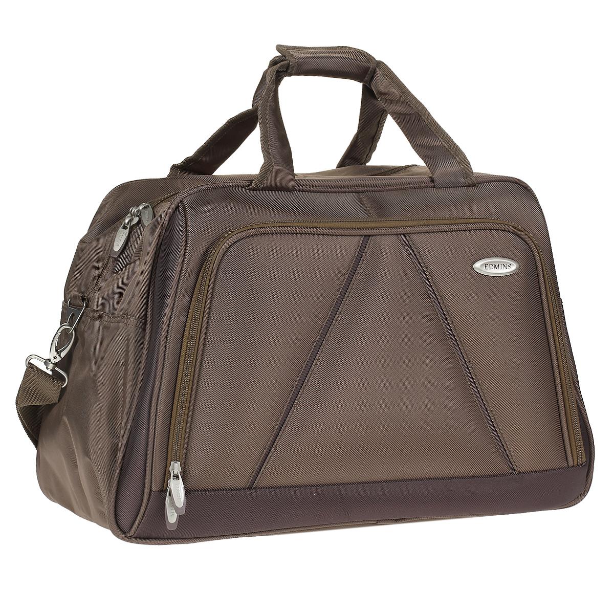 Сумка дорожная Edmins, цвет: бронза. 243 CV243 CV 420*5Стильная дорожная сумка Edmins выполнена из плотного полиэстера бронзового цвета. Сумка имеет одно вместительное отделение, закрывающееся на застежку-молнию. Сумка снабжена механическим замком с двумя ключами. Внутри содержится вшитый карман на молнии и перегородка. На лицевой стороне расположен накладной карман на молнии. На задней стенке - карман для мелочей на липучке. Сумка оснащена двумя удобными ручками и отстегивающимся плечевым ремнем регулируемой длины. На дне - пластиковые ножки. Фурнитура - серебристого цвета. Функциональная и вместительная, такая сумка поможет не только уместить все необходимые вещи, но и станет модным аксессуаром, который идеально дополнит ваш образ. Может использоваться в качестве ручной клади. Характеристики: Материал: полиэстер, металл, пластик. Размер сумки: 50 см х 30 см х 25 см. Цвет: бронза. Высота ручек: 20 см. Длина плечевого ремня (регулируется): 75 см. Максимальная нагрузка: 7 кг.