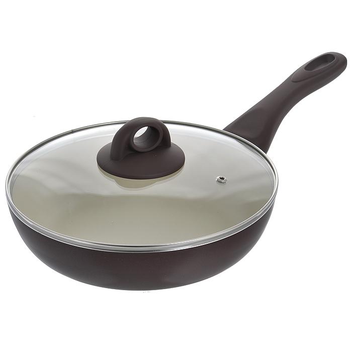 Сковорода глубокая Jarko Dark Chocolate с крышкой, с антипригарным покрытием, цвет: коричневый. Диаметр 24 смJDC-124-21DСковорода Jarko Dark Chocolate изготовлена из высококачественного алюминия со светлым внутренним антипригарным покрытием нового поколения. Покрытие, позволяющее готовить при высоких температурах (до 240°С), не оставляет послевкусия, делает возможным приготовление блюд без масла, сохраняет витамины и питательные вещества. Оно обладает повышенной стойкостью к царапинам и внешним воздействиям. Покрытие экологически безопасно, не содержит PFOA и не выделяет вредных соединений при нагреве. Внешнее темное жаростойкое покрытие обеспечивает легкую чистку. Улучшенная теплопроводимость обеспечивает моментальный нагрев и работу в энергосберегающем режиме. Сковорода оснащена эргономичной ручкой из бакелита с покрытием Soft-Touch. Крышка из термостойкого стекла снабжена металлическим ободом, удобной бакелитовой ручкой и отверстием для выпуска пара. Такая крышка позволит следить за процессом приготовления пищи без потери тепла. Она плотно прилегает к краям ...