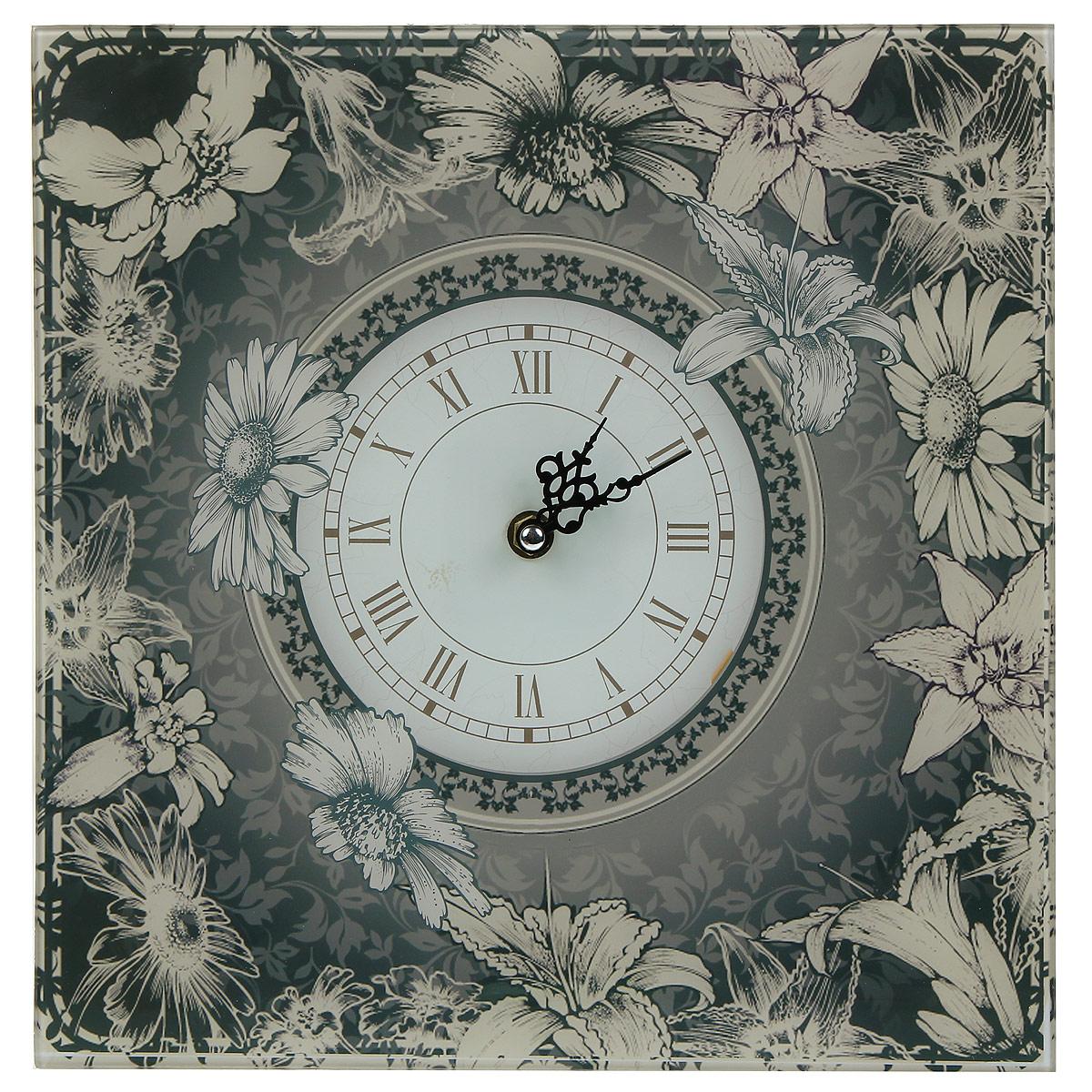 Часы настенные Цветочки. 2779827798Настенные часы квадратной формы Цветочки своим эксклюзивным дизайном подчеркнут оригинальность интерьера вашего дома. Часы выполнены из выполнены из высококачественного стекла и оформлены оригинальным рисунком. Часы имеют две фигурные стрелки - часовую и минутную. Циферблат часов не защищен стеклом. Настенные часы Цветочки подходят для кухни, гостиной, прихожей или дачи, а также могут стать отличным подарком для друзей и близких. Часы работают от одной батарейки типа АА (не входят в комплект).
