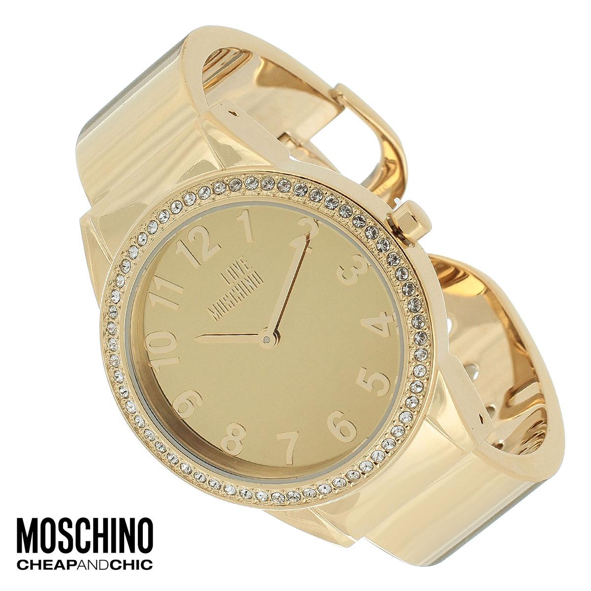 Часы женские наручные Moschino, цвет: золотой. MW0441MW0441Наручные часы от известного итальянского бренда Moschino - это не только стильный и функциональный аксессуар, но и современные технологи, сочетающиеся с экстравагантным дизайном и индивидуальностью. Часы Moschino оснащены кварцевым механизмом. Корпус выполнен из высококачественной нержавеющей стали с PVD-покрытием и по контуру циферблата оформлен стразами. Циферблат оформлен арабскими цифрами, надписью Love Moschino и защищен минеральным стеклом. Часы имеют две стрелки - часовую и минутную. Браслет часов выполнен из нержавеющей стали и имеет разъемную конструкцию. Часы упакованы в фирменную металлическую коробку с логотипом бренда. Часы Moschino благодаря своему уникальному дизайну отличаются от часов других марок своеобразными циферблатами, функциональностью, а также набором уникальных технических свойств. Каждой модели присуща легкая экстравагантность, самобытность и, безусловно, великолепный вкус. Характеристики: Диаметр...