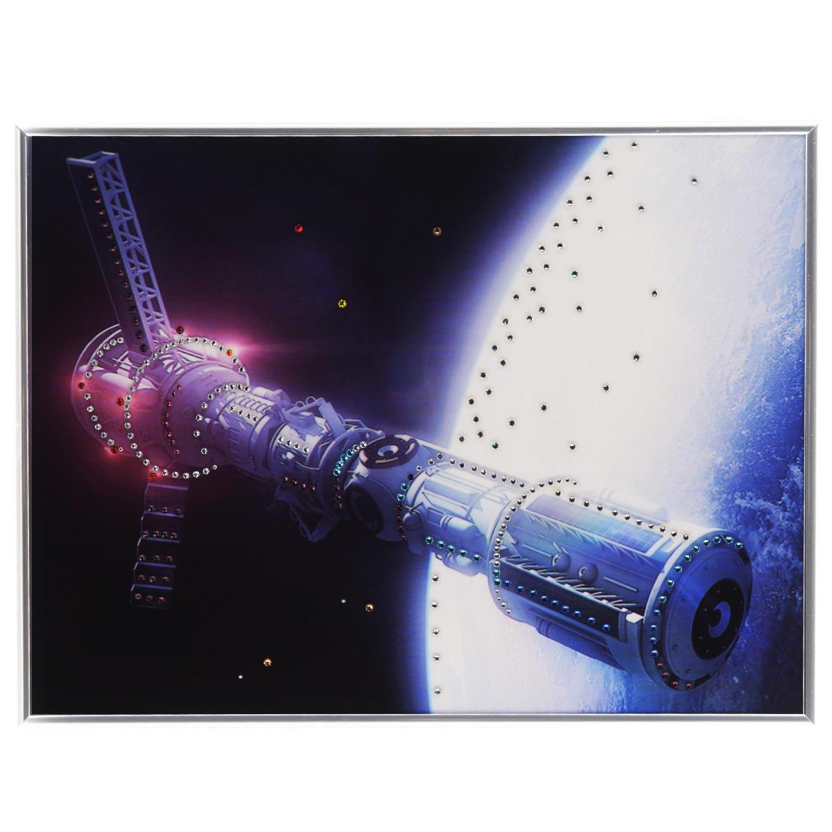 Картина с кристаллами Swarovski В космосе, 40 см х 30 смES-412Изящная картина в металлической раме, инкрустирована кристаллами Swarovski, которые отличаются четкой и ровной огранкой, ярким блеском и чистотой цвета. Красочное изображение космического корабля, расположенное под стеклом, прекрасно дополняет блеск кристаллов. С обратной стороны имеется металлическая петелька для размещения картины на стене. Картина с кристаллами Swarovski В космосе элегантно украсит интерьер дома или офиса, а также станет прекрасным подарком, который обязательно понравится получателю. Блеск кристаллов в интерьере, что может быть сказочнее и удивительнее. Картина упакована в подарочную картонную коробку синего цвета и комплектуется сертификатом соответствия Swarovski.