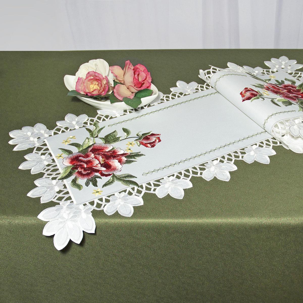 Дорожка для декорирования стола Schaefer, прямоугольная, цвет: белый, красный, 40 x 110 см 07481-233VT-1520(SR)Дорожка Schaefer выполнена из высококачественного полиэстера и украшена вышитыми рисунками в виде цветов. Края дорожки оформлены в технике ришелье. Вы можете использовать дорожку для декорирования стола, комода или журнального столика.Благодаря такой дорожке вы защитите поверхность мебели от воды, пятен и механических воздействий, а также создадите атмосферу уюта и домашнего тепла в интерьере вашей квартиры. Изделия из искусственных волокон легко стирать: они не мнутся, не садятся и быстро сохнут, они более долговечны, чем изделия из натуральных волокон.Изысканный текстиль от немецкой компании Schaefer - это красота, стиль и уют в вашем доме. Дорожка органично впишется в интерьер любого помещения, а оригинальный дизайн удовлетворит даже самый изысканный вкус. Дарите себе и близким красоту каждый день!