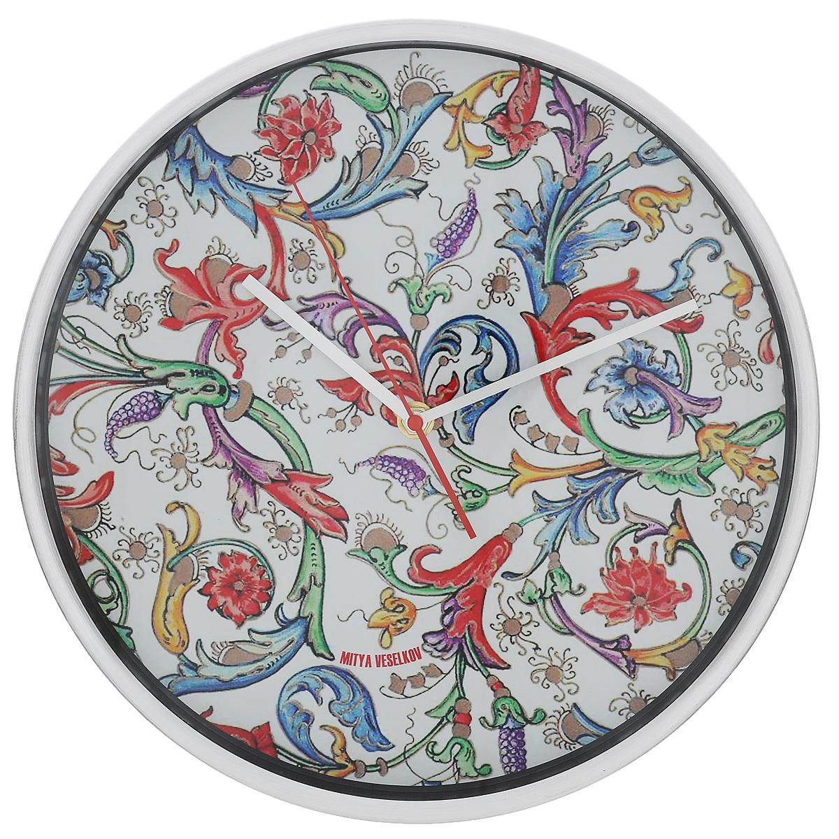 Часы настенные Райский сад (30см). MV-NAST082MV-NAST082Оригинальные настенные часы Mitya Veselkov Райский сад прекрасно дополнят интерьер комнаты. Круглый корпус часов выполнен из металла серебристого цвета с матовой полировкой. Циферблат оформлен красивыми узорами и защищен стеклом. Часы имеют три стрелки - часовую, минутную и секундную. Оформите свой дом таким интерьерным аксессуаром или преподнесите его в качестве презента друзьям, и они оценят ваш оригинальный вкус и неординарность подарка. Диаметр часов: 30 см. Толщина корпуса: 4 см. Часы работают от 1 батарейки типа АА (в комплект не входит).