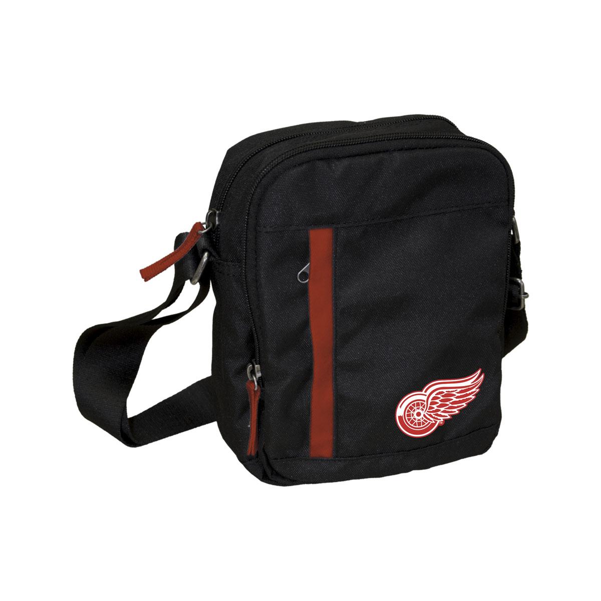Сумка на ремне NHL Red Wings, цвет: черный, 3,5 л. 5801729058Универсальная сумка NHL Red Wings на регулируемом плечевом ремне имеет два отделения на молнии. Внешний карман на молнии отделан контрастной полосой. Основное отделение содержит четыре небольших кармана для мелочей, один из них на молнии. Сумка украшена эмблемой хоккейной команды Red Wings.