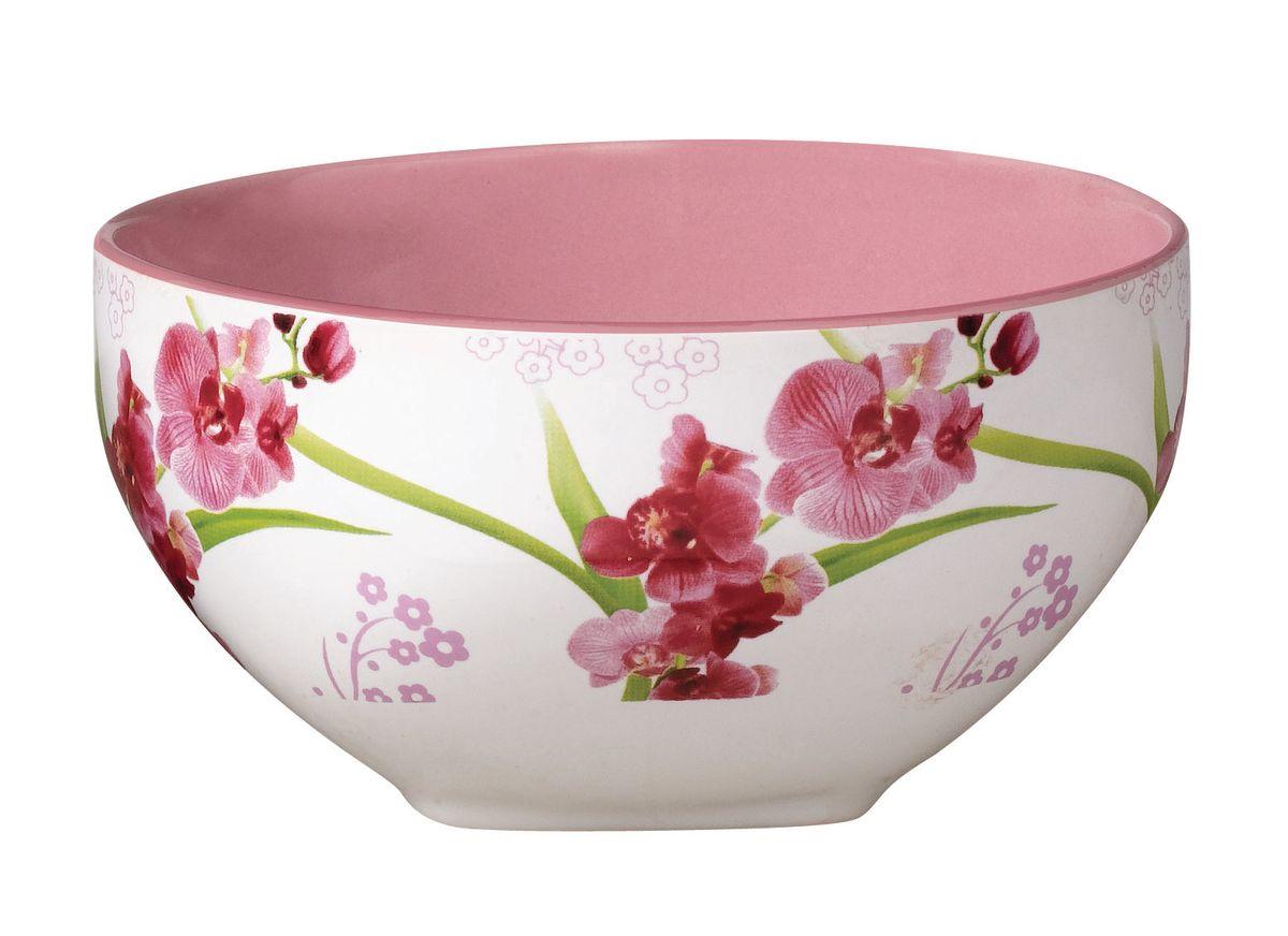 Салатник Орхидея, 510 млTLSD15-19Салатник Орхидея, выполненный из высококачественной керамики, круглой формы с квадратным основанием. Изделие украшено красочным изображением орхидей. Салатник прекрасно подойдет для сервировки различных блюд. Яркий дизайн украсит стол и порадует вас и ваших гостей. Диаметр: 13,5 см. Высота: 7 см. Объем: 510 мл.