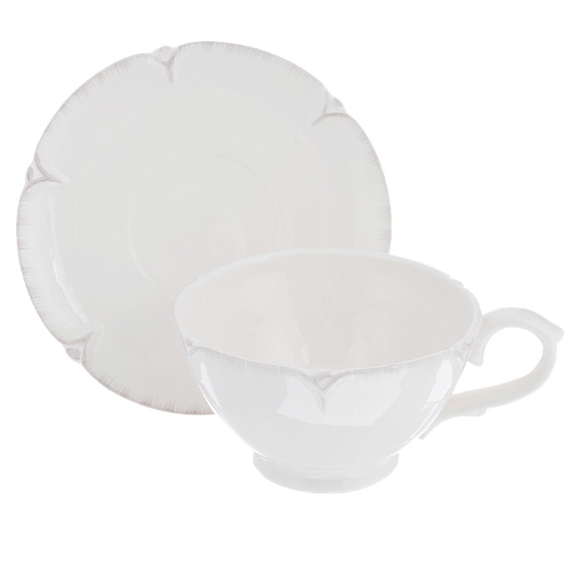 Чайная пара Lillo Ideal, 2 предмета. 214951214951Чайная пара Lillo Ideal сочетает в себе изысканный дизайн с максимальной функциональностью. Чашка с блюдцем выполнены из высококачественной керамики. Оформление придется по вкусу и ценителям классики, и тем, кто предпочитает утонченность и изысканность. Такая чайная пара станет отличным сувениром для ваших друзей и близких. Можно использовать в посудомоечной машине и микроволновой печи.