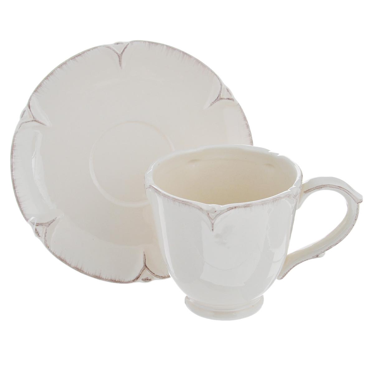 Чайная пара Lillo Ideal, 2 предмета. 214203214203Чайная пара Lillo Ideal сочетает в себе изысканный дизайн с максимальной функциональностью. Чашка с блюдцем выполнены из высококачественной керамики. Оформление придется по вкусу и ценителям классики, и тем, кто предпочитает утонченность и изысканность. Такая чайная пара станет отличным сувениром для ваших друзей и близких. Можно использовать в посудомоечной машине и микроволновой печи. Диаметр чашки по верхнему краю: 9 см. Высота чашки: 9 см. Объем чашки: 300 мл. Диаметр блюдца: 15 см.