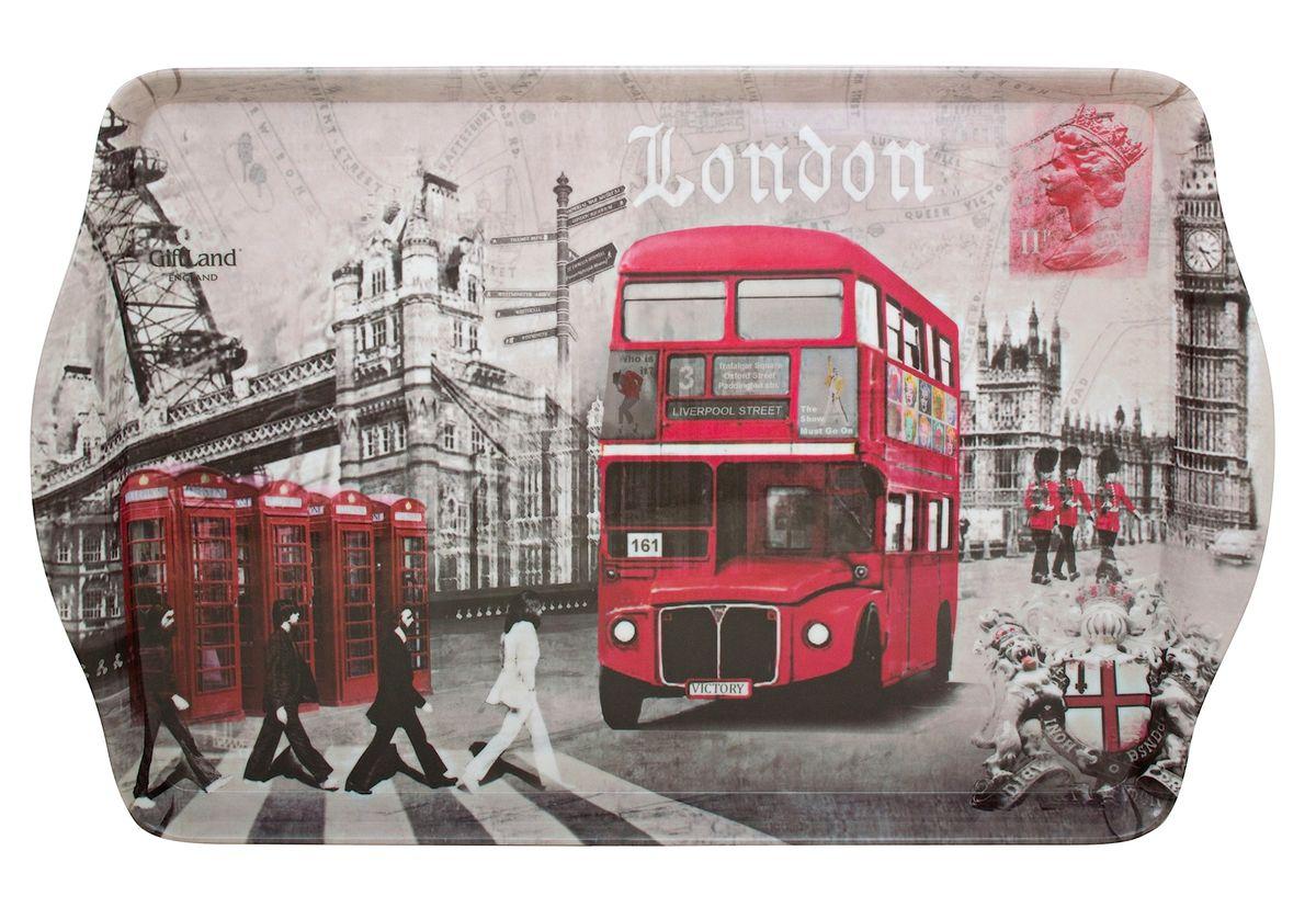 Поднос сервировочный GiftLand London Crossroads, 38,8 x 24 смML001-L2Прямоугольный поднос GiftLand London Crossroads выполнен из высококачественного, жаропрочного пластика и украшен изображением достопримечательностей Лондона. Красочный дизайн подноса придаст оригинальность и яркость любой кухне или столовой. Такой поднос станет незаменимым предметом для сервировки стола. Компактный поднос предохранит поверхность стола от грязи и перегрева. Размер подноса: 38,8 см x 24 см. Высота подноса: 2,2 см.