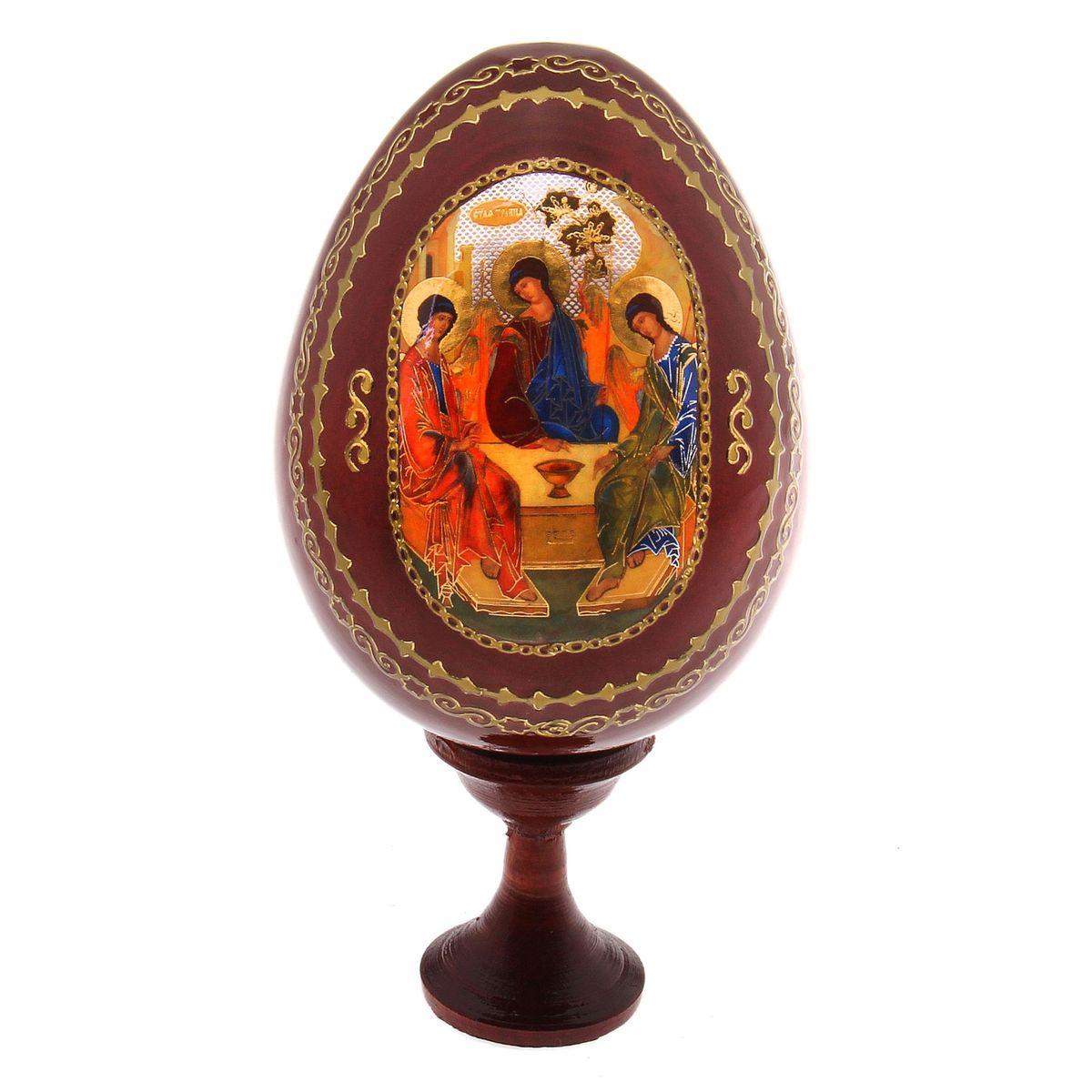 Яйцо декоративное Sima-land Троица, на подставке, высота 14,5 смUP210DFДекоративное яйцо Sima-land Троица изготовлено из дерева с лаковым покрытием. Яйцо оформлено изображением Святой Троицы и золотыми узорами. Изделие располагается на деревянной подставке. Декоративное яйцо Sima-land Троица принесет в ваш дом ощущение торжества, душевного уюта и станет идеальным подарком на Пасху. Диаметр яйца: 7,5 см. Высота яйца: 10,5 см. Размер подставки: 3,2 см х 3,2 см х 4 см.
