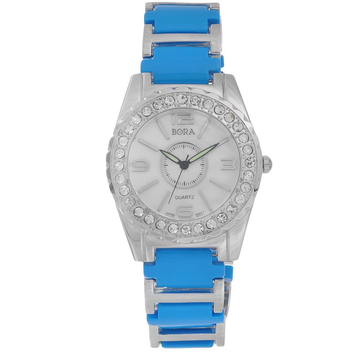 Часы наручные женские Bora, цвет: голубой, серебряный. FWBR052 / T-B-8527-WATCH-TURQUOISEFWBR052 / T-B-8527-WATCH-TURQUOISEЧасы торговой марки Bora отличает изысканный стиль и превосходное качество изготовления. Японский механизм Seiko отличает невероятная точность. С ними вы точно не пропустите ничего интересного. Корпус часов выполнен из легированного металлического сплава и украшен стразами. Ремешок изготовлен из металла и ювелирного пластика и застегивается на застежку-клипсу. Практичная и незаменимая вещь в сумасшедшем ритме современной жизни. Стильный и элегантный аксессуар идеально дополнит ваш повседневный образ. Характеристики: Размеры корпуса: 4 х 4,5 х 1 см. Размеры ремешка без учета корпуса: 16 х 2 см.