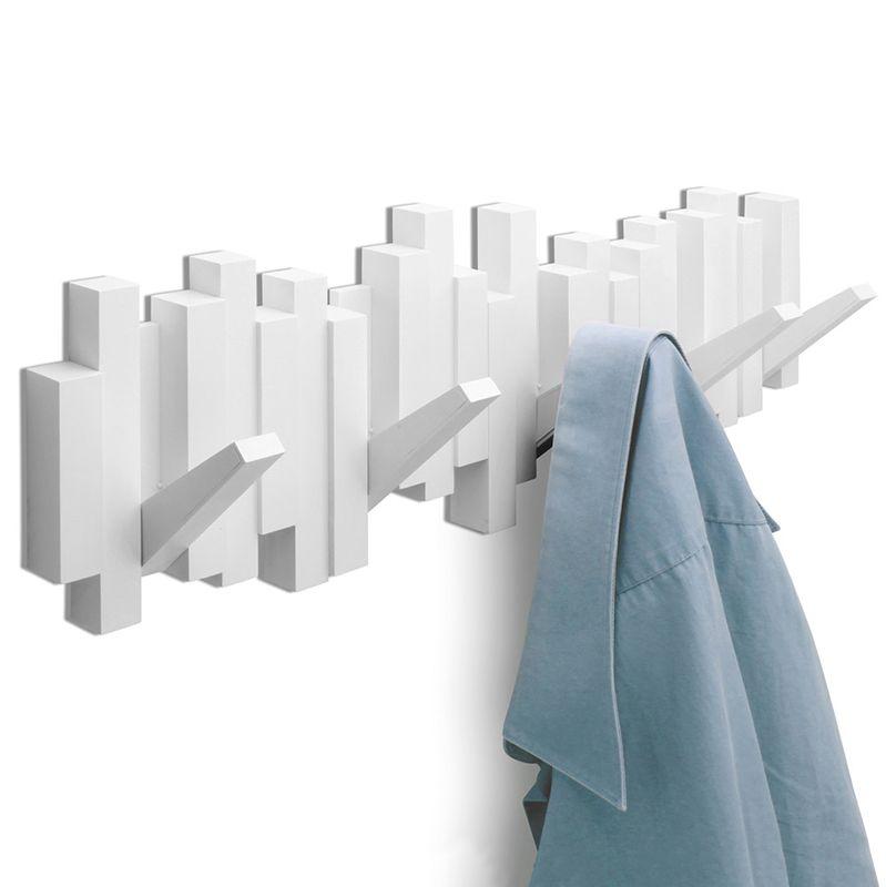 Вешалка настенная Umbra Sticks, цвет: белый, 5 крючков318211-660Стильная и прочная вешалка Umbra Sticks интересной формы и оригинального дизайна изготовлена из прочного пластика. Имеет 5 откидных и прочных крючков. Когда они не используются, то складываются, превращая конструкцию в плоский декоративный элемент стильной формы. Вешалка Umbra Sticks идеально подходит для маленьких прихожих и ограниченных пространств. Каждый крючок выдерживает вес до 2,3 кг. Размер вешалки: 50 см х 17 см х 2 см.