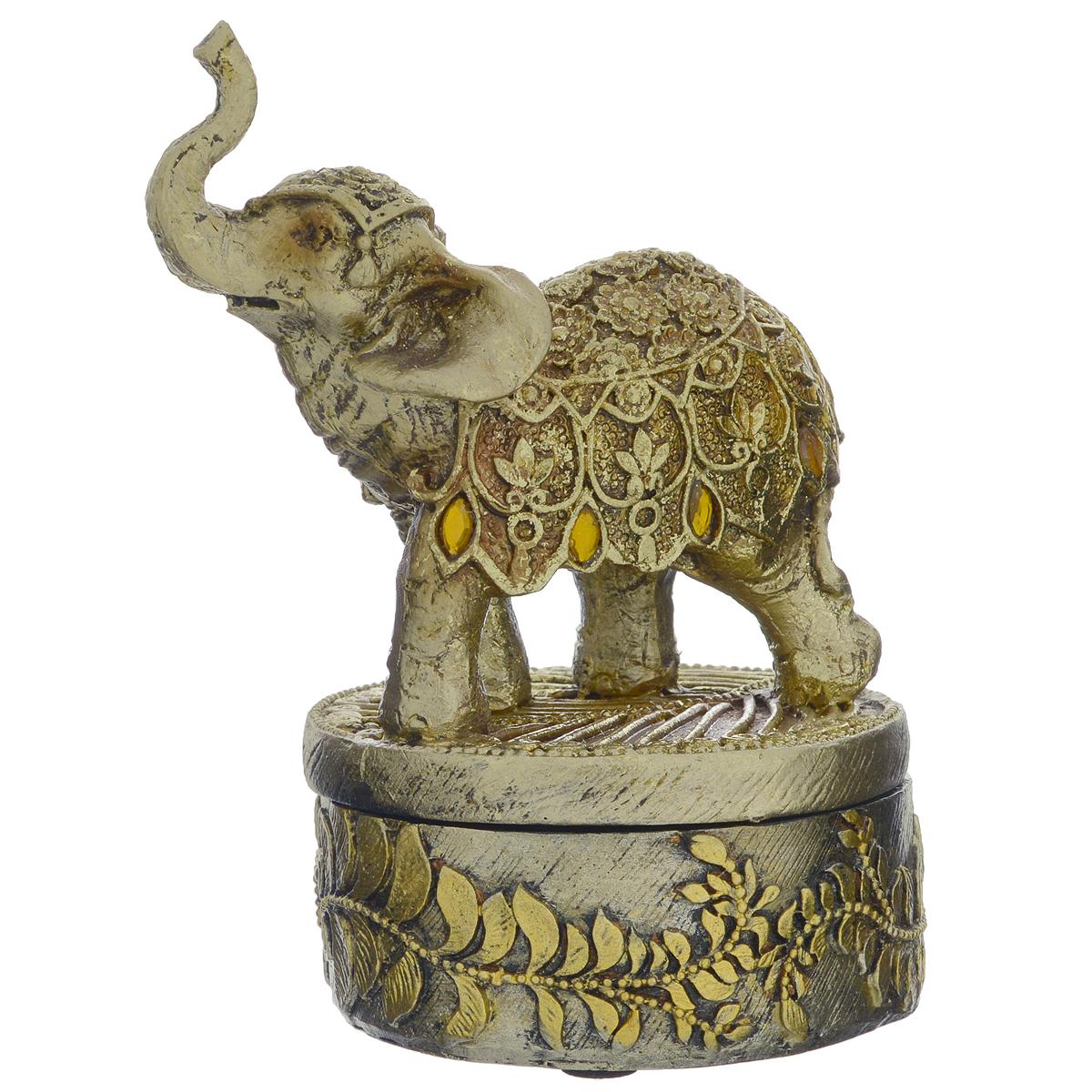 Фигурка декоративная Molento Умный слон, высота 13,5 см549-202Декоративная фигурка Molento Умный слон, изготовленная из полистоуна, выполнена в виде слона на постаменте и украшена рельефным рисунком и стразами. Такая фигурка станет отличным дополнением к интерьеру. Вы можете поставить фигурку в любом месте, где она будет удачно смотреться, и радовать глаз. Кроме того, фигурка Умный слон станет чудесным сувениром для ваших друзей и близких. Размер фигурки: 10 см х 8 см х 13,5 см.