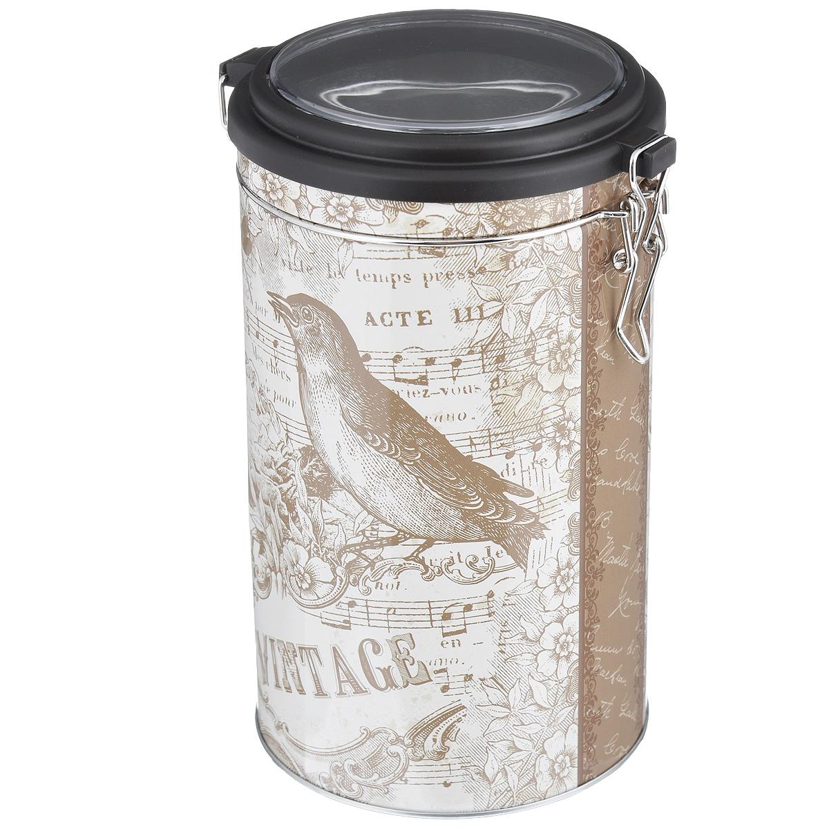 Банка для сыпучих продуктов Феникс-презент Птица, 1,5 л37633Банка для сыпучих продуктов Феникс-презент Птица, изготовленная из окрашенного черного металла, оформлена ярким рисунком. Банка прекрасно подойдет для хранения различных сыпучих продуктов: специй, чая, кофе, сахара, круп и многого другого. Емкость плотно закрывается прозрачной пластиковой крышкой на металлический замок. Благодаря этому она будет дольше сохранять свежесть ваших продуктов. Функциональная и вместительная, такая банка станет незаменимым аксессуаром на любой кухне. Нельзя мыть в посудомоечной машине. Объем банки: 1,5 л. Высота банки (без учета крышки): 17,4 см. Диаметр банки (по верхнему краю): 10,5 см.