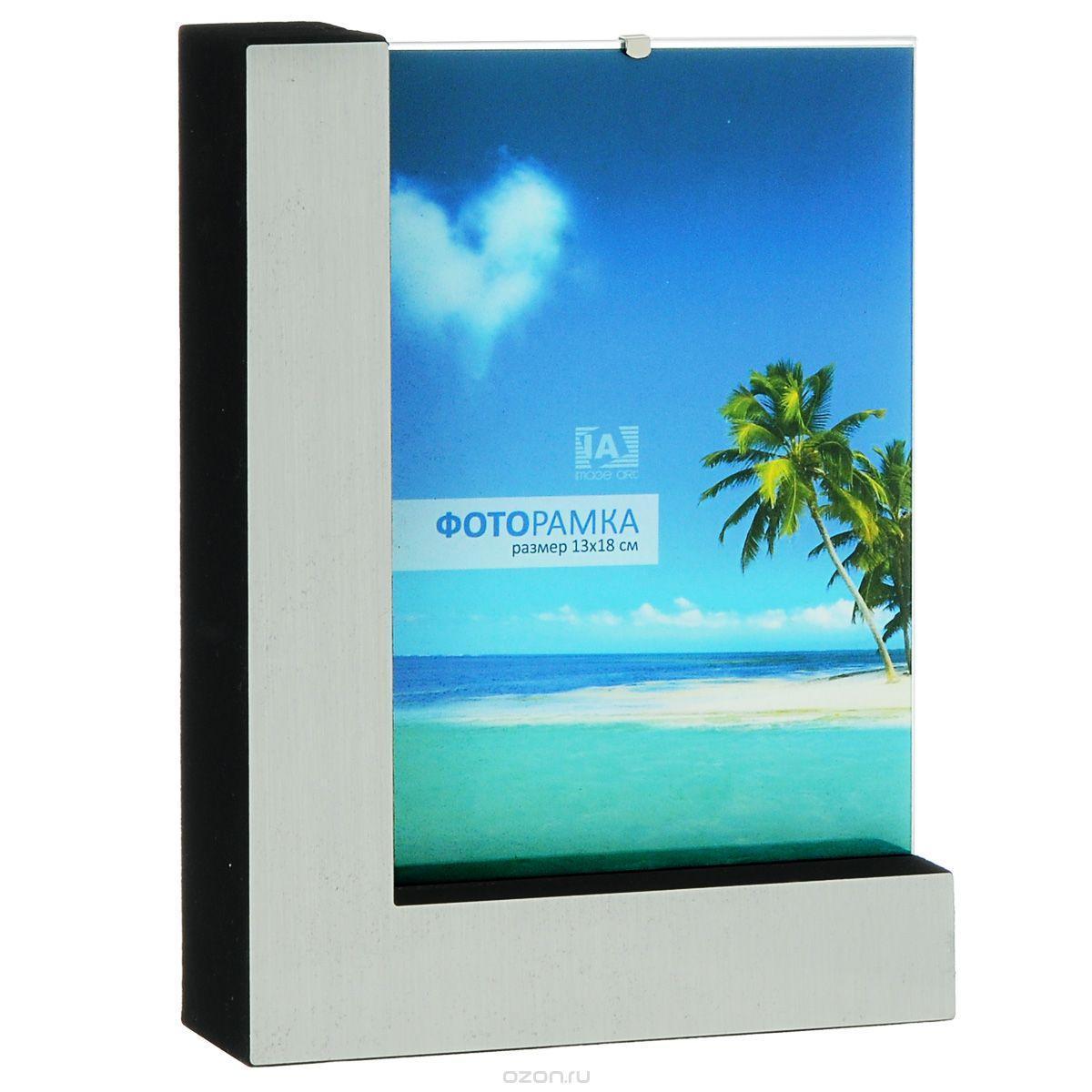 Фоторамка Image Art 6026-5S6026-5SФоторамка Image Art - прекрасный способ красиво оформить ваши фотографии. Изделие рассчитано на 2 фотографии. Фоторамка выполнена из металла и защищена стеклом. Фоторамку можно поставить на стол или подвесить на стену, для чего с задней стороны предусмотрены специальные отверстия. Такая фоторамка поможет сохранить на память самые яркие моменты вашей жизни, а стильный дизайн сделает ее прекрасным дополнением интерьера.