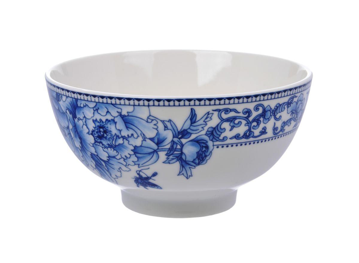 Салатница Nanshan Porcelain Наньшань, цвет: белый, синий, диаметр 12,5 см115610Салатница Nanshan Porcelain Наньшань изготовлена из высококачественной керамики с подглазурной деколью, которая защищает рисунок от истирания и продлевает срок эксплуатации посуды. Изделие безопасно для здоровья и окружающей среды, не содержит свинец и кадмий. Внешние стенки оформлены изящным рисунком. Такая салатница прекрасно подходит для холодных и горячих блюд: каш, хлопьев, супов, салатов. Она дополнит коллекцию вашей кухонной посуды и будет служить долгие годы. Можно использовать в посудомоечной машине и СВЧ. Диаметр салатницы (по верхнему краю): 12,5 см. Высота: 6,5 см.