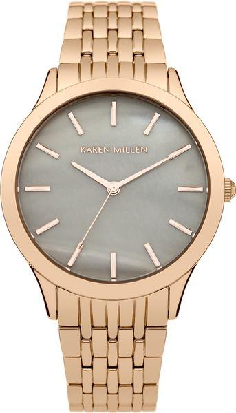 Часы наручные женские Karen Millen, цвет: золотой. KM106ERGMKM106ERGMЭлегантные женские часы Karen Millen изготовлены из нержавеющей стали с IP-покрытием и минерального стекла. Циферблат часов оформлен символикой бренда, а также перламутровой вставкой. Корпус изделия оснащен кварцевым механизмом, который имеет степень влагозащиты равную 5 Bar, дополнен устойчивым к царапинам минеральным стеклом. Браслет оснащен замком-клипсой, который позволит с легкостью снимать и надевать изделие. Часы поставляются в фирменной упаковке. Часы Karen Millen подчеркнут изящность женской руки и отменное чувство стиля у их обладательницы.