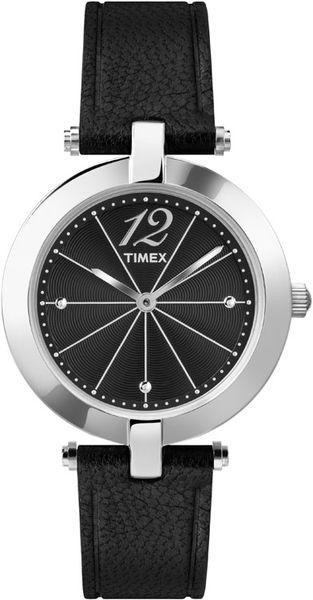 Часы наручные женские Timex, цвет: серебристый, черный. T2P544T2P544Великолепные женские наручные часы Timex выполнены из нержавеющей стали. Циферблат изделия оформлен арабскими цифрами, отметками, часовой и минутной стрелками. Также циферблат дополнен логотипом Timex. Часы оснащены кварцевым механизмом и устойчивым к царапинам минеральным стеклом. Модель обладает степенью влагозащиты 3 atm. Изделие дополнено ремешком из натуральной кожи c тиснением, позволяющим максимально комфортно и быстро снимать и одевать часы при помощи пряжки. Часы поставляются на специальной подушечке в стильной коробке с логотипом Timex. Стильные часы заставят окружающих обратить на вас внимание.