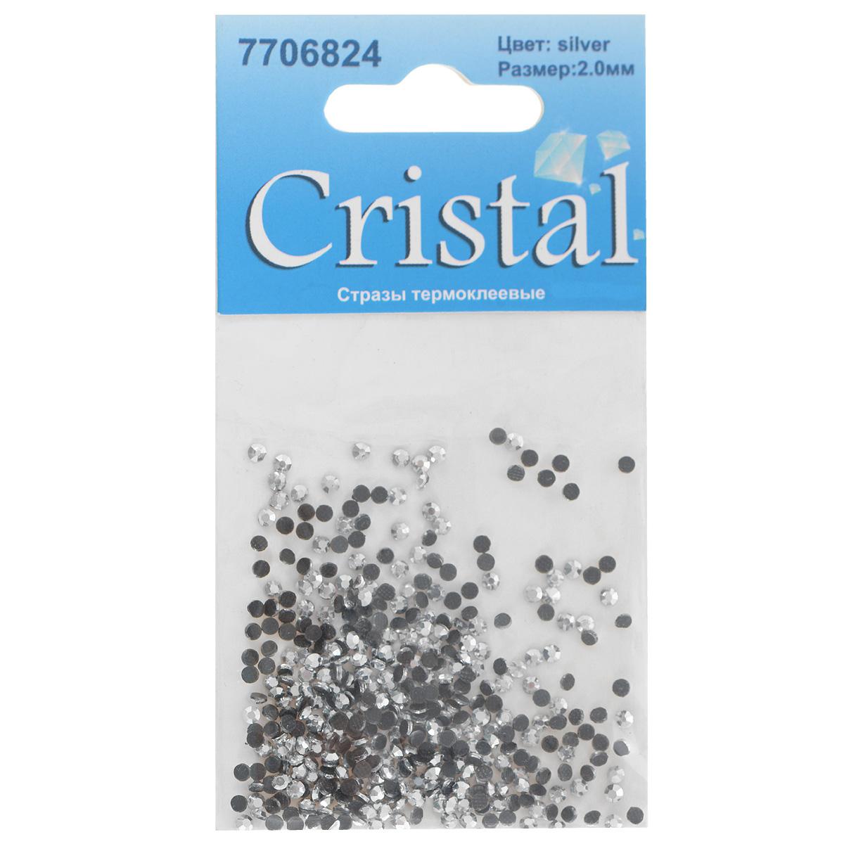 Стразы термоклеевые Cristal, цвет: серебристый, диаметр 2 мм, 432 шт7706824_сереброНабор термоклеевых страз Cristal, изготовленный из высококачественного акрила, позволит вам украсить одежду, аксессуары или текстиль. Яркие стразы имеют плоское дно и круглую поверхность с гранями. Дно термоклеевых страз уже обработано особым клеем, который под воздействием высоких температур начинает плавиться, приклеиваясь, таким образом, к требуемой поверхности. Чаще всего их используют в текстильной промышленности: стразы прикладывают к ткани и проглаживают утюгом с обратной стороны. Также можно использовать специальный паяльник. Украшение стразами поможет сделать любую вещь оригинальной и неповторимой. Диаметр страз: 2 мм.