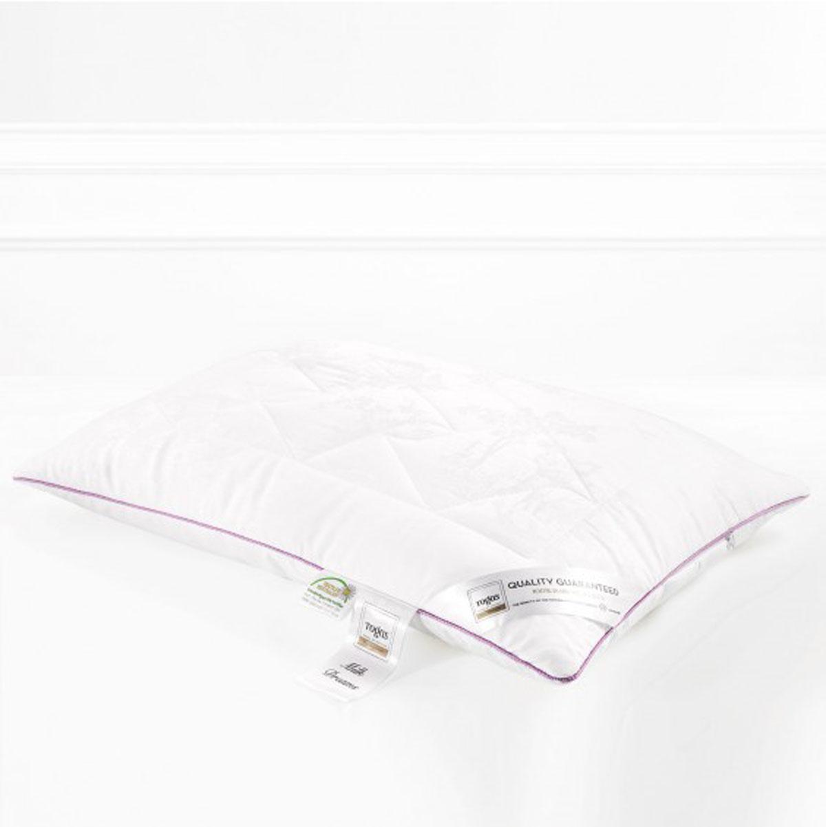 Подушка Togas Милк дримс, наполнитель: молочное волокно, 70 х 70 см20.05.16.0072Чехол подушки Togas Милк дримс выполнен из жаккарда (100% модал). Наполнитель подушки изготовлен из молочного волокна. Модал – материал нового поколения, появился сравнительно недавно. Несмотря на синтетическое происхождение, он считается экологически чистым, так как изготовлен из 100% древесной целлюлозы. Целлюлоза для модала используется высококачественная, чаще всего из эвкалиптового дерева, бука, сосны. Молочное волокно имеет гипоаллергенные и антибактериальные свойства. Наполнитель из молочного волокна отлично поглощает лишнюю влагу, не препятствует естественному дыханию кожи во время сна и при этом сохраняет все свои свойства после многократных стирок. Такая подушка абсолютно натуральна и безопасна. Она дарит всю пользу молока вашей коже, насыщая ее во время сна аминокислотами, микроэлементами и оказывая на нее естественно увлажняющее и стимулирующее кровообращение действие.