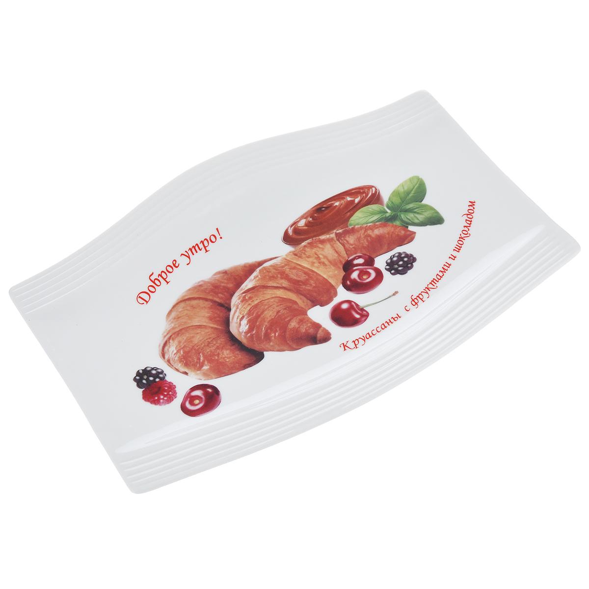 Блюдо LarangE Круассаны с фруктами и шоколадом, 25 х 17,5 см589-320Блюдо LarangE Круассаны с фруктами и шоколадом изготовлено из прочного высококачественного фарфора. Изделие украшено изображением сырников. Пусть ваше утро начинается с незабываемого завтрака! Можно использовать в СВЧ печах, духовом шкафу и холодильнике. Не применять абразивные чистящие вещества. Размер блюда: 25 см х 17,5 см. Высота блюда: 2 см.