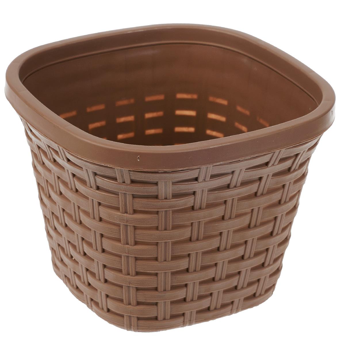 Кашпо Violet Ротанг, с дренажной системой, цвет: какао, 2,6 л33260/17Кашпо Violet Ротанг изготовлено из высококачественного пластика и оснащено дренажной системой для быстрого отведения избытка воды при поливе. Изделие прекрасно подходит для выращивания растений и цветов в домашних условиях. Лаконичный дизайн впишется в интерьер любого помещения. Объем: 2,6 л.