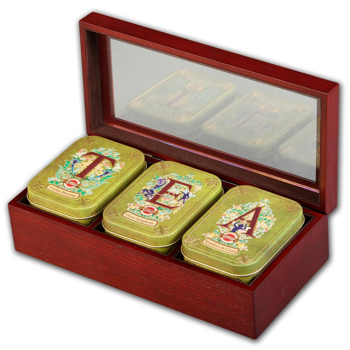 Hilltop Tea набор зеленого и черного листового чая в подарочной шкатулке, 150 г4607099303072Hilltop Tea - все, что нужно для удовольствия от чаепития. Деревянная шкатулка со стеклянной крышкой скрывает в себе три жестяные чайницы с великолепными вкусами! Отличный подарок для истинных ценителей чая. Цейлонское утро — классический цейлонский черный чай с терпким вкусом, мягким ароматом и тонизирующими свойствами. Отлично дополняет завтрак или праздничный сладкий стол. Зеленая симфония — китайский зеленый чай с добавлением лепестков календулы и мальвы и с ароматом тропического манго. Земляника со сливками — крупнолистовой черный чай с листьями и плодами земляники, и со вкусом свежих сливок. Классика ароматизированных чаев. Попробуйте охлажденным, с добавлением кусочков льда!
