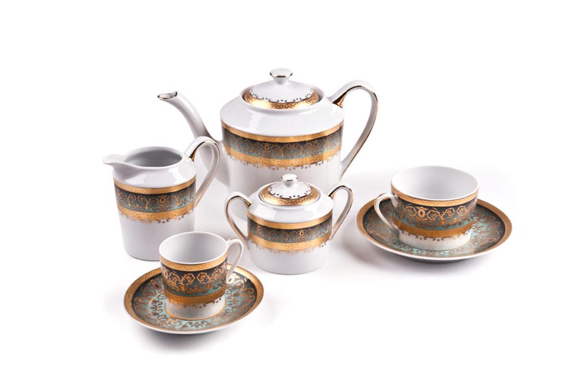 Сервиз чайный Tunise Porcelaine, 15пр, цвет: бело-зеленый с золотом115510Чайник 1,2л, сахарница 250мл, молочник 300мл, чайная пара 220 мл *6 штук . Фарфор фабрики Tunisie Porcelaine, производится в Тунисе из знаменитой своим качеством и белизной глины, добываемой во французской провинции Лимож.Преимущества этого фарфора заключаются в устойчивости к сколам и трещинам, что возможно благодаря двойному термическому обжигу. Европейский дизайн, декор и формы обеспечиваются за счет тесного сотрудничества фабрики с ведущими мировыми дизайн-бюро такими как: Nelly Reynal, Yves De la Rosiere, Sarah Anderson, Heracles. Материал: фарфор: цвет: бело-зеленый с золотомСерия: MIMOSA