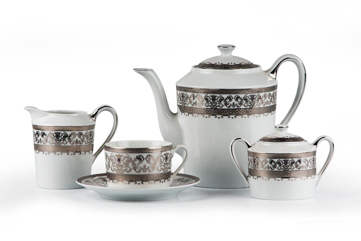 Mimosa 1647, сервиз чайный 15 предметов, цвет: белый с платиной539509 1647Чайник 1,2л, сахарница 250мл, молочник 300мл, чайная пара 220 мл *6 штук . Фарфор фабрики Tunisie Porcelaine, производится в Тунисе из знаменитой своим качеством и белизной глины, добываемой во французской провинции Лимож.Преимущества этого фарфора заключаются в устойчивости к сколам и трещинам, что возможно благодаря двойному термическому обжигу. Европейский дизайн, декор и формы обеспечиваются за счет тесного сотрудничества фабрики с ведущими мировыми дизайн-бюро такими как: Nelly Reynal, Yves De la Rosiere, Sarah Anderson, Heracles. Материал: фарфор: цвет: белый с платиной Серия: Prague Platine