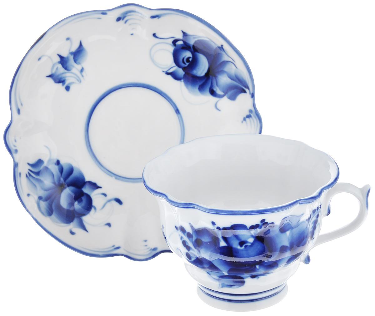 Чайная пара Орхидея, цвет: белый, синий, 2 предмета993040712Чайная пара Орхидея состоит из чашки и блюдца, выполненных из высококачественной керамики и оформленных гжельской росписью. Яркий дизайн, несомненно, придется вам по вкусу. Чайная пара Орхидея украсит ваш кухонный стол, а также станет замечательным подарком к любому празднику. Уважаемые клиенты! Обратите ваше внимание, что роспись на изделии выполнена вручную. Рисунок может немного отличаться от изображения на фотографии. Объем чашки: 250 мл. Диаметр чашки (по верхнему краю): 11 см. Диаметр дна чашки: 5,5 см. Высота чашки: 7,5 см. Диаметр блюдца: 15,5 см.