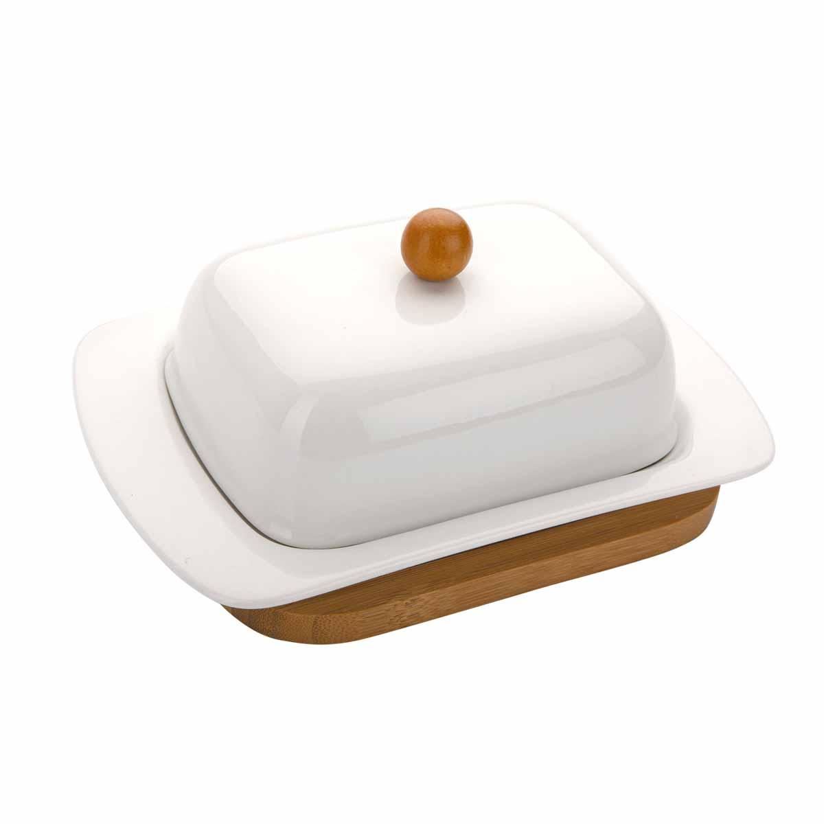 Масленка Dekok, на подставкеPW-2709Масленка Dekok, выполненная из высококачественного фарфора, предназначена для красивой сервировки и хранения масла. Изделие размещено на подставке из бамбука. Благодаря экологичным материалам, масло в такой масленке долго остается свежим, а при хранении в холодильнике не впитывает посторонние запахи. Масленка Dekok станет незаменимой на вашей кухне. Размер масленки (с учетом крышки): 18,5 см х 12 см х 8 см. Размер подставки: 16 см х 12,5 см х 1,1 см.