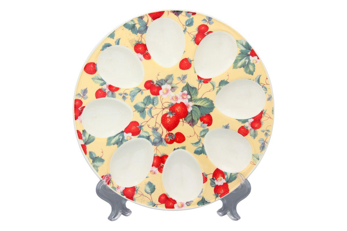 Тарелка для фаршированных яиц Elan Gallery Земляника, цвет: желтый, красный, зеленый, диаметр 20 см101020Тарелка для фаршированных яиц Elan Gallery Земляника выполнена из керамики и украшена изображением ягод и цветов. На изделии имеются специальные углубления для 8 яиц Такая тарелка украсит сервировку вашего стола и подчеркнет прекрасный вкус хозяйки. Диаметр тарелки: 20 см. Высота тарелки: 2 см. Не рекомендуется применять абразивные моющие средства. Не использовать в микроволновой печи.
