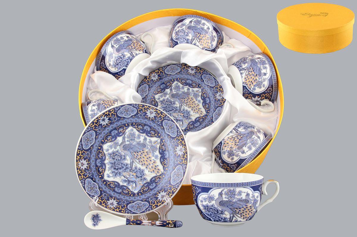 Набор чайный Elan Gallery Павлин синий, 18 предметов180787Чайный набор Elan Gallery Павлин синий состоит из 6 чашек, 6 блюдец и 6 ложек. Изделия, выполненные из высококачественной керамики, имеют элегантный дизайн и классическую форму. Такой набор прекрасно подойдет как для повседневного использования, так и для праздников. Чайный набор Elan Gallery Павлин синий - это не только яркий и полезный подарок для родных и близких, это также великолепное дизайнерское решение для вашей кухни или столовой. Не использовать в микроволновой печи. Объем чашки: 250 мл. Диаметр чашки (по верхнему краю): 9,5 см. Высота чашки: 6 см. Диаметр блюдца (по верхнему краю): 14 см. Высота блюдца: 2 см. Длина ложки: 12,5 см.