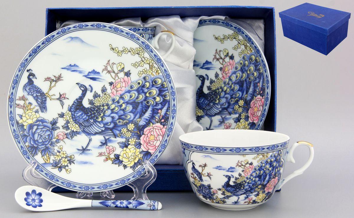 Набор чайный Elan Gallery Павлин, 6 предметов180795Чайный набор Elan Gallery Павлин состоит из двух чашек, двух блюдец и двух ложек, выполненных из высококачественной керамики. Изделия декорированы красивым цветочным рисунком и изображением павлинов. Элегантная чайная пара на 2 персоны в нежных тонах станет памятным подарком. Объем чашки: 250 мл. Диаметр чашки (по верхнему краю): 9,5 см. Высота чашки: 6,2 см. Диаметр блюдца (по верхнему краю): 15,2 см. Высота блюдца: 1,8 см. Общая длина ложки: 12,5 см. Размер рабочей поверхности ложки: 4,5 см х 2,5 см.