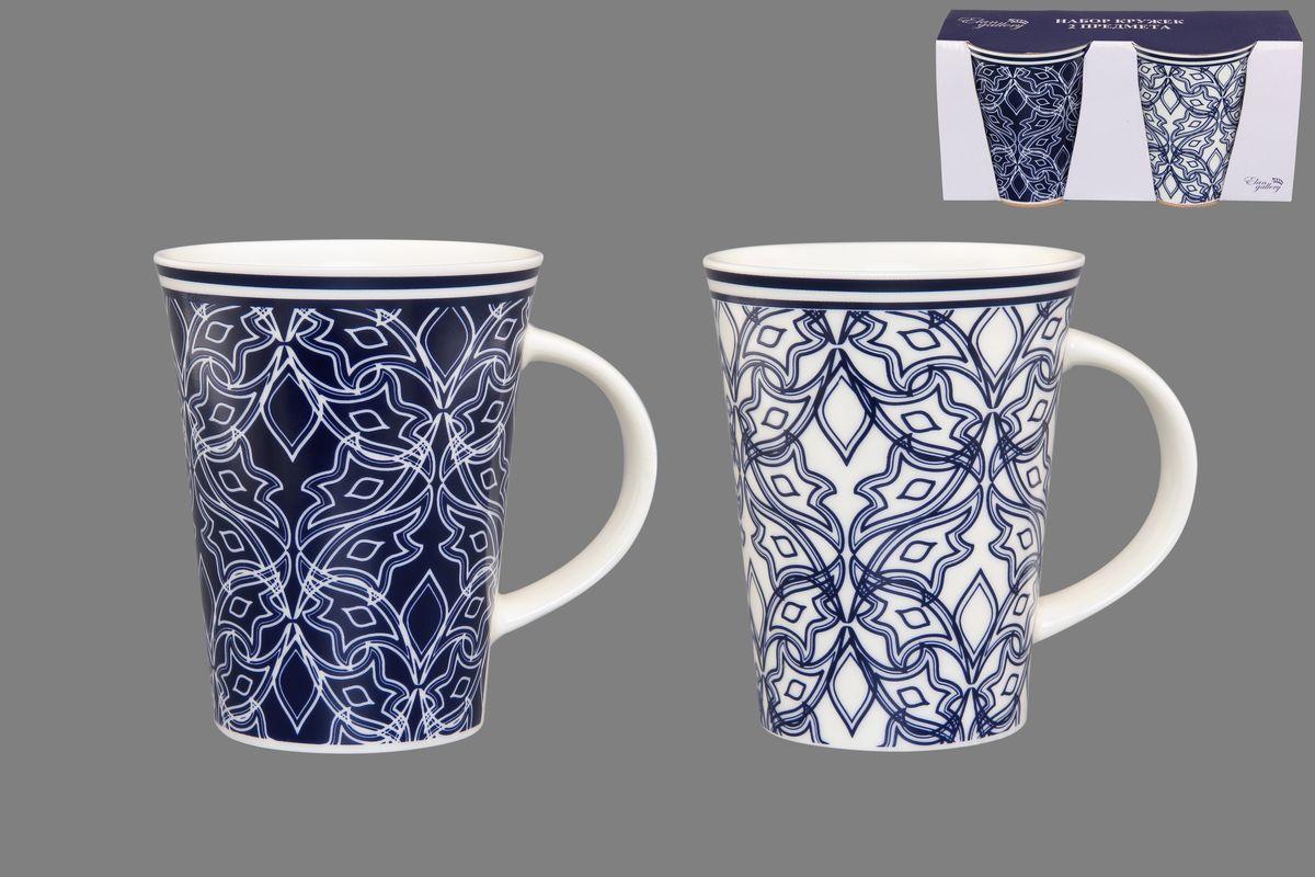 Набор кружек Elan Gallery Изящный узор, цвет: белый, синий, 320 мл, 2 шт250075Набор Elan Gallery Изящный узор состоит из двух кружек, выполненных из керамики. Этот необычный набор станет великолепным подарком для каждого и, несомненно, вызовет восхищение. Объем кружек: 320 мл. Диаметр кружек (по верхнему краю): 8,5 см. Высота кружек: 11 см. Не рекомендуется применять абразивные моющие средства. Не использовать в микроволновой печи.