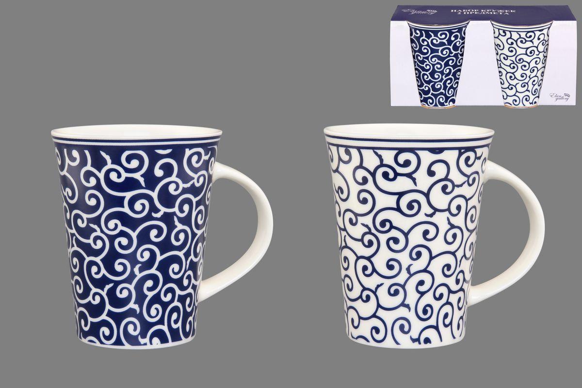 Набор кружек Elan Gallery Арабески, цвет: белый, синий, 320 мл, 2 шт250076Набор Elan Gallery Арабески состоит из двух кружек, выполненных из керамики. Этот необычный набор станет великолепным подарком для каждого и, несомненно, вызовет восхищение. Объем кружек: 320 мл. Диаметр кружек (по верхнему краю): 8,5 см. Высота кружек: 11 см. Не рекомендуется применять абразивные моющие средства. Не использовать в микроволновой печи.