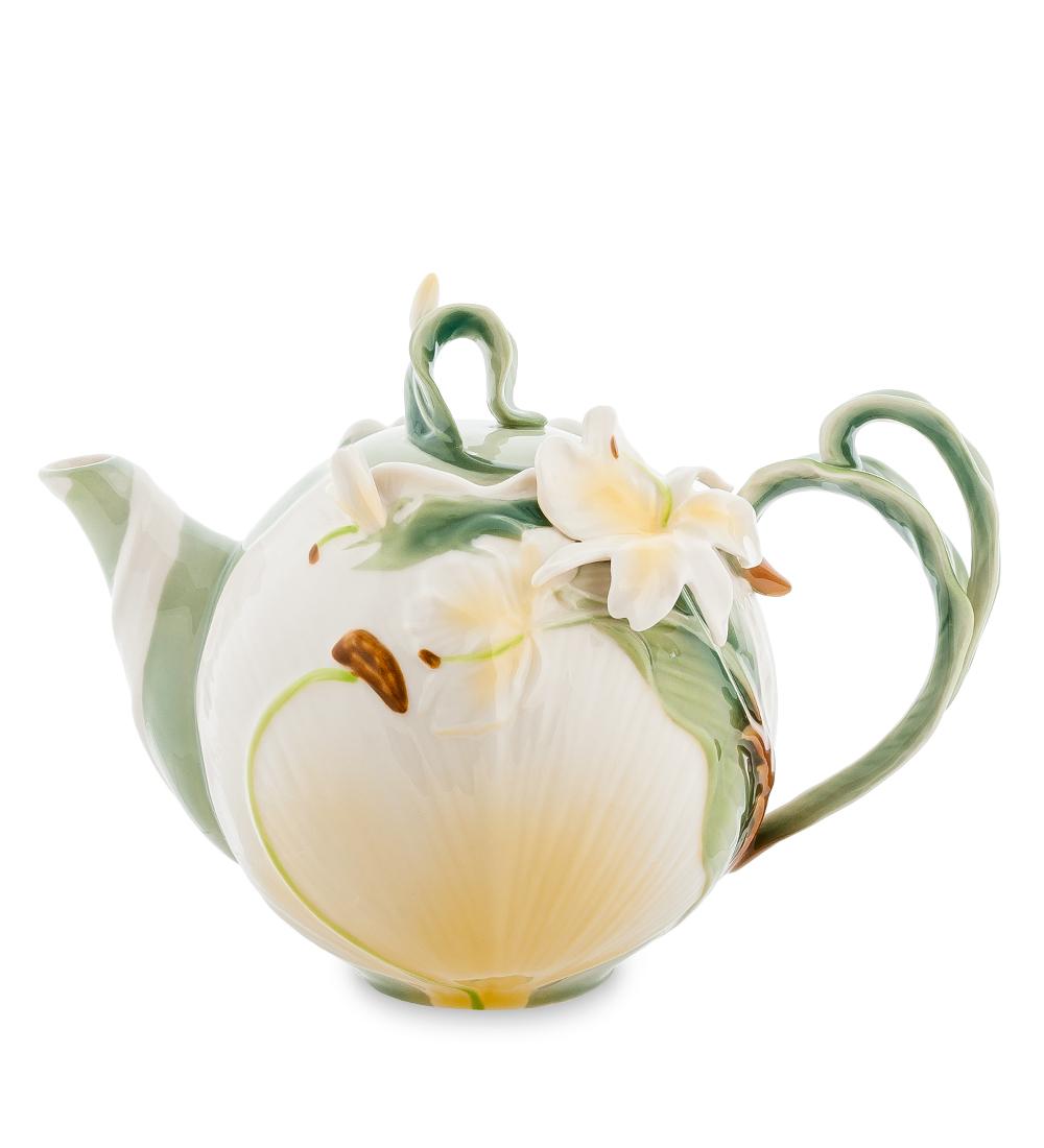 Чайник заварочный Pavone Лилия, 1,2 л104301Заварочный чайник Pavone Лилия изготовлен из высококачественного фарфора. Оригинальное исполнение придает модели особый шарм, который понравится каждому. Чайник снабжен удобной ручкой, носиком и крышкой. Такой заварочный чайник красиво дополнит сервировку стола к чаепитию и станет полезным приобретением для любой хозяйки. Отличный подарок к любому случаю. Высота: 17 см. Объем чайника: 1,2 л.