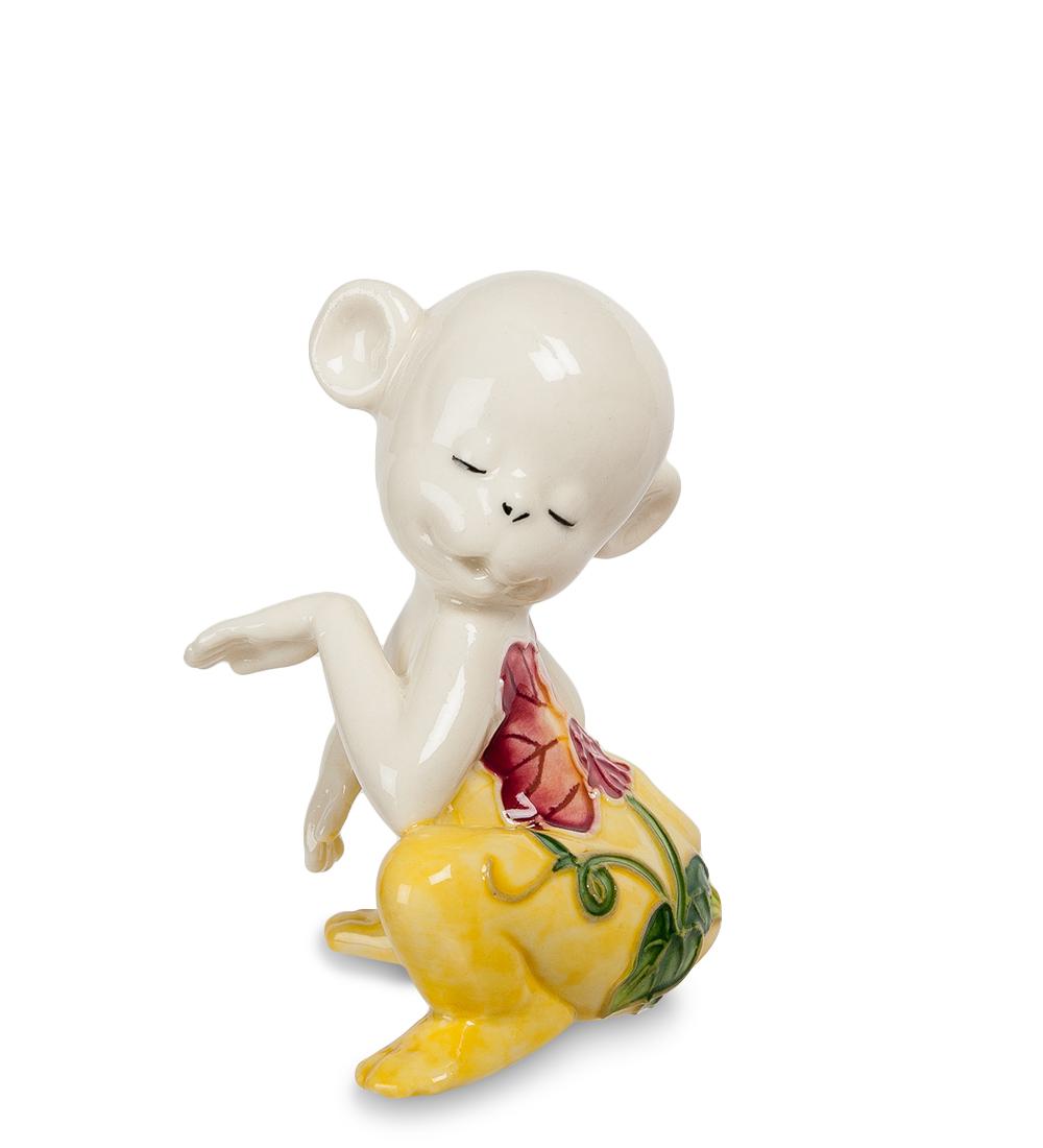 Фигурка декоративная Pavone Обезьяна, цвет: белый, желтый. 107429KT415EДекоративная фигурка Pavone Обезьяна станет оригинальным подарком для всех любителей стильных вещей. Сувенир выполнен из высококачественного фарфора в виде обезьянки, украшенной оригинальным узором. Изысканный сувенир станет прекрасным дополнением к интерьеру. Вы можете поставить фигурку в любом месте, где она будет удачно смотреться и радовать глаз.Высота фигурки: 8 см.
