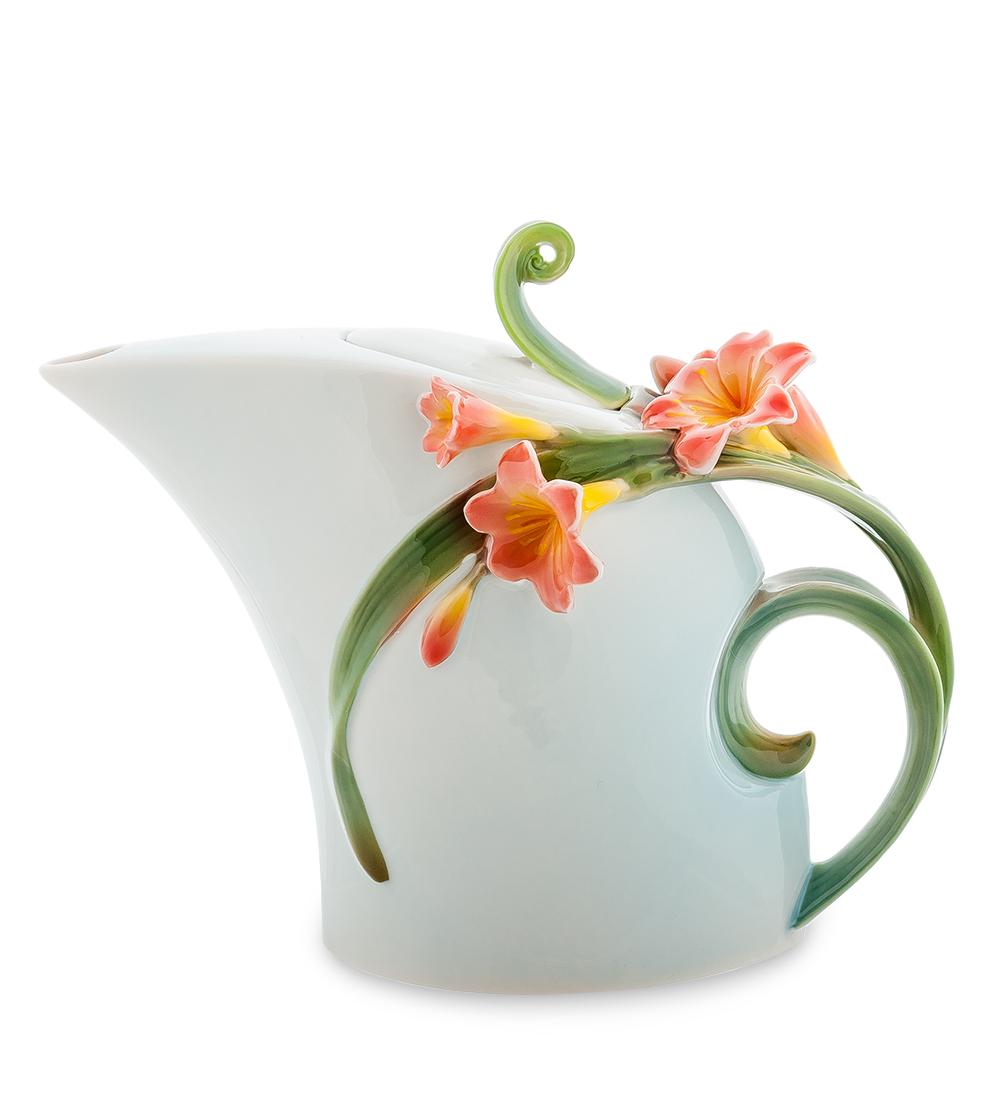 Чайник заварочный Pavone Кливия, цвет: голубой, зеленый, 850 мл94672Чайник заварочный Pavone Кливия изготовлен из высококачественной фарфора. Изделие оформлено изящными объемными цветами. Такой чайник прекрасно дополнит сервировку стола к чаепитию и станет его неизменным атрибутом.Изделие упаковано в подарочную коробку с атласной подложкой. Объем: 850 мл. Размеры по по верхнему краю: 3,5 см х 5 см. Высота стенки (без учета крышки): 16 см.