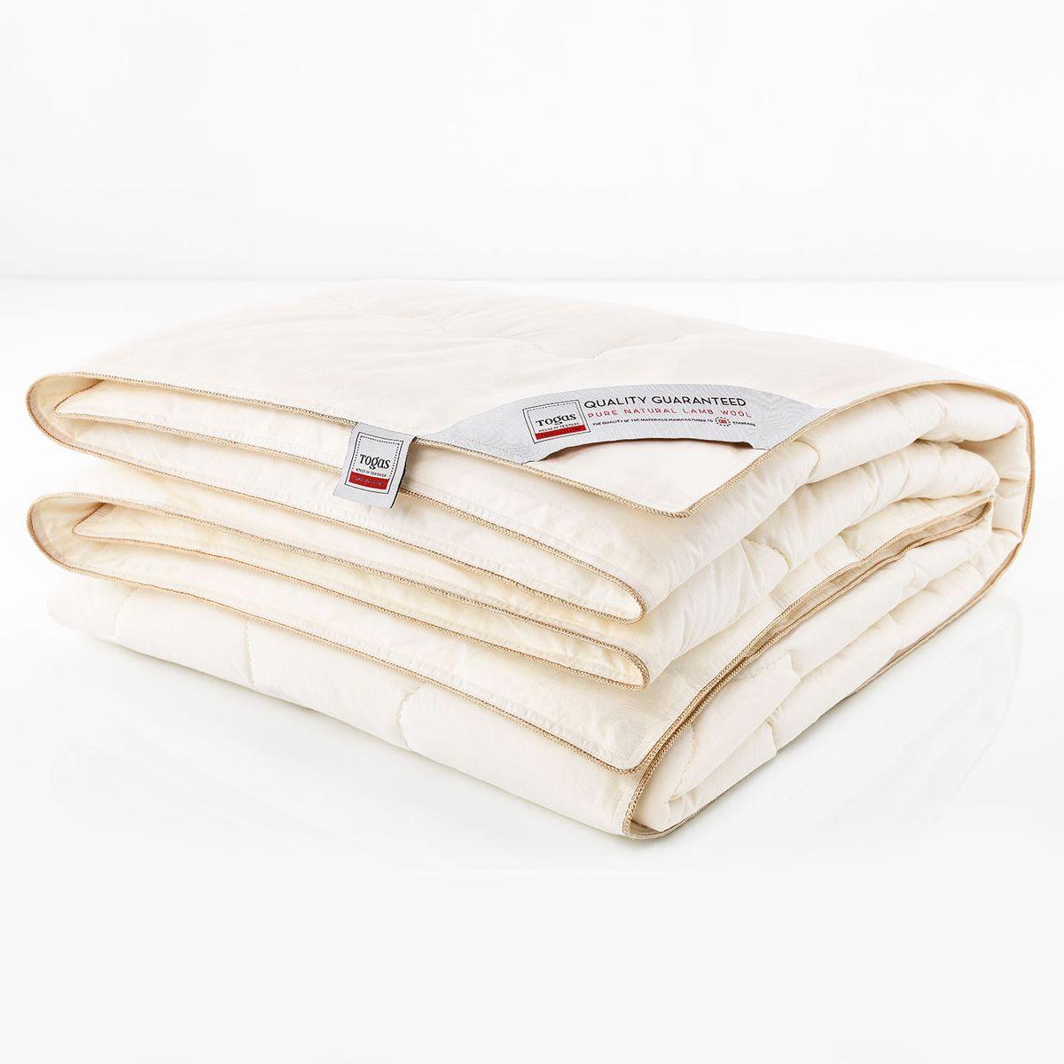 """Одеяло Togas Прима, наполнитель: овечья шерсть, 200 х 210 см10503Овечья шерсть используется для изготовления подушек и одеял с незапамятных времен. Трудно переоценить их драгоценные свойства, рожденные самой природой. Сильный ветер и перепады температур на горных пастбищах, где испокон веков пасутся овцы, способствовали образованию роскошной легкой шубки, которая согревает в самый суровый холод - и отлично вентилирует в жару. Людям удалось создать материалы, аналогичные по своим теплорегулирующим свойствам, - но повторить целебные свойства шерсти не смог еще ни один ученый. Овечья шерсть содержит природное вещество - ланолин. Поэтому одеяла из натуральной шерсти рекомендуют людям, страдающим радикулитом, остеохондрозом и повышенным кровяным давлением. Шерсть способна создавать сухое тепло, которое оказывает благотворное воздействие на суставы. Такие одеяла по-настоящему """"дышат"""": между шерстяными волокнами постоянно циркулирует воздух, который помогает выводить лишнее тепло и влагу, создавая идеальный микроклимат во время сна. Нежное ощущение тепла и комфорта оказывает оздоравливающий, бодрящий эффект, который Вы чувствуете каждое утро. Овечьи одеяла очень износостойки, неприхотливы и просты в уходе, - они прослужат вам долгие годы, не потеряв своей формы и удивительных свойств."""