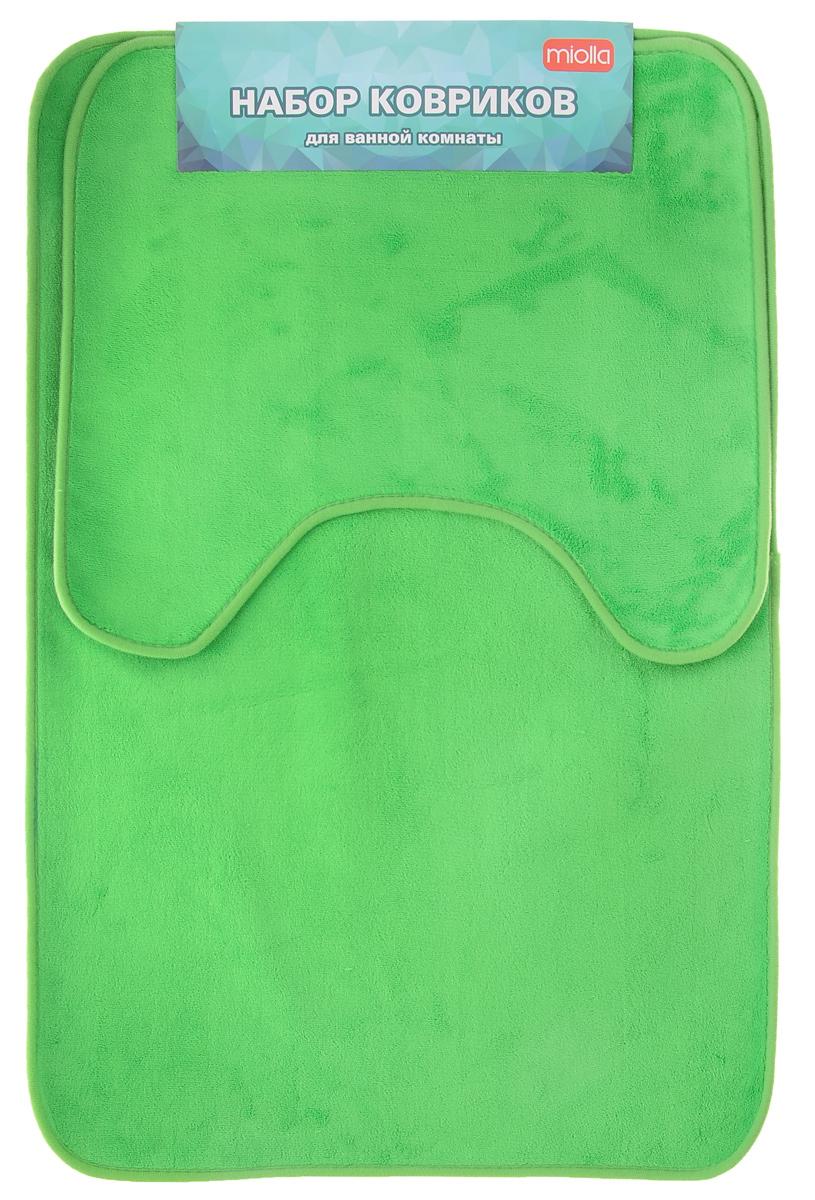 Набор ковриков для ванной Miolla, цвет: зеленый, 2 шт106-029Набор Miolla состоит из двух ковриков для ванной комнаты: прямоугольного и с вырезом. Изделия изготовлены из 100% полиэстера. Благодаря специальной обработки нижней стороны, коврики не скользят на плитке. Яркий дизайн позволит оформить ванную комнату по вашему вкусу .Размер ковриков: 75 см х 48 см; 45 см х 40 см.