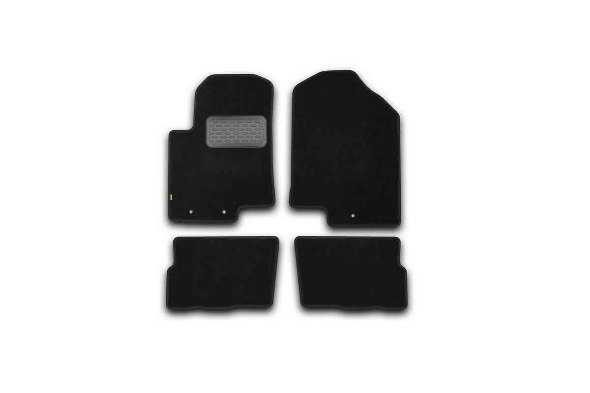 Набор автомобильных ковриков Klever для Kia Soul 2008-, хэтчбек, в салон, 4 шт. KVR02253701210khKVR02253701210khНабор автомобильных ковриков Klever, изготовленный из текстиля, состоит из 4 ковриков, которые учитывают все особенности каждой модели автомобиля и полностью повторяют контуры пола. Текстильные автомобильные коврики для салона произведены из высококачественного материала, который держит форму, прочный и не пачкает обувь. Коврики в салон не только улучшат внешний вид салона вашего автомобиля, но и надежно уберегут его от пыли, грязи и сырости, а значит, защитят кузов от коррозии. Текстильные коврики для автомобиля мягкие и приятные, а их основа из вспененного полиуретана не пропускает влагу. Ковры для автомобилей надежно крепятся на полу и не скользят, что очень важно во время движения. Чистятся коврики очень просто: как при помощи автомобильного пылесоса, так и различными моющими средствами. Набор подходит для Kia Soul хэтчбек с 2008 года выпуска.