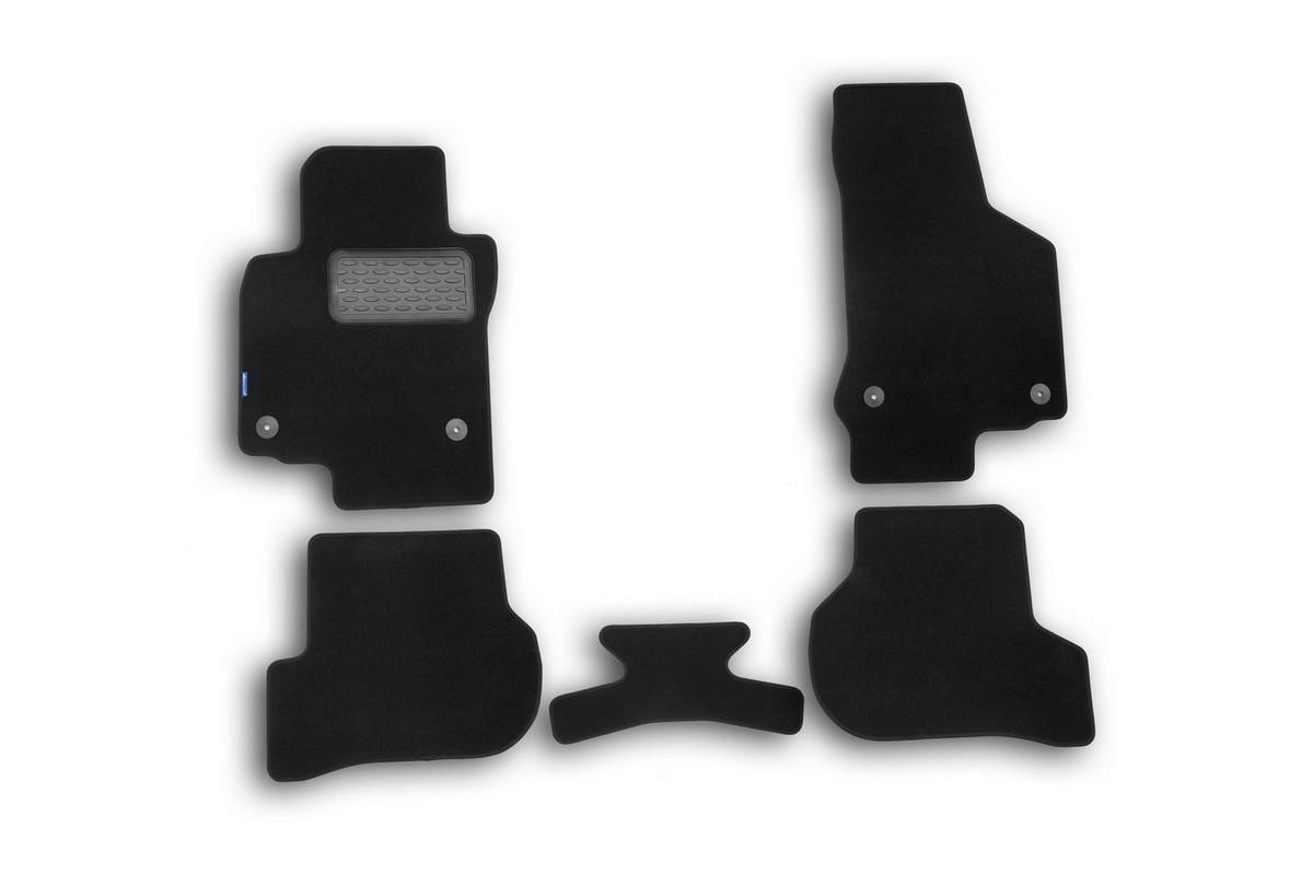 Набор автомобильных ковриков в салон Novline-Autofamily для VW Golf GTI 3d, 2009 -, хэтчбек, 5 штNLT.51.35.11.110khНабор автомобильных ковриков Novline-Autofamily, изготовленный из текстиля, состоит из 5 ковриков, которые учитывают все особенности каждой модели автомобиля и полностью повторяют контуры пола. Текстильные автомобильные коврики для салона произведены из высококачественного материала, который держит форму, прочный и не пачкает обувь. Коврики в салон не только улучшат внешний вид салона вашего автомобиля, но и надежно уберегут его от пыли, грязи и сырости, а значит, защитят кузов от коррозии. Текстильные коврики для автомобиля мягкие и приятные, а их основа из вспененного полиуретана не пропускает влагу. Ковры для автомобилей надежно крепятся на полу и не скользят, что очень важно во время движения. Чистятся коврики очень просто: как при помощи автомобильного пылесоса, так и различными моющими средствами. Набор подходит для Volkswagen Golf GTI 3D хэтчбек c 2009 года выпуска.