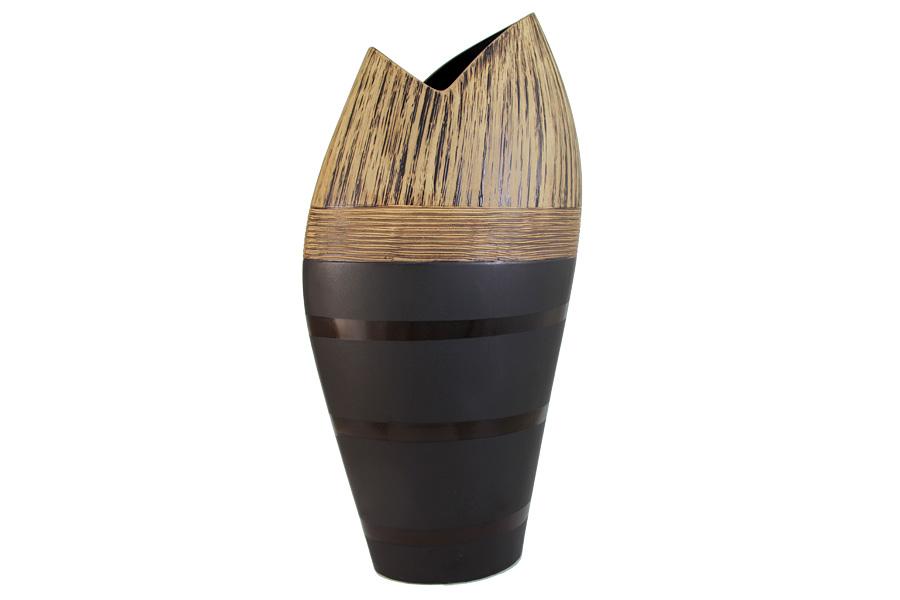 Ваза SDJ Бангкок, высота 46 смSDJ-1-603323-3-ALИзящная ваза SDJ Бангкок, изготовленная из высококачественной керамики, выполнена в этническом стиле. Она красиво переливается и излучает приятный блеск. Изделие имеет оригинальную форму, что делает ее изящным украшением интерьера. Ваза SDJ Бангкок дополнит интерьер офиса или дома и станет желанным и стильным подарком. Высота вазы: 46 см.