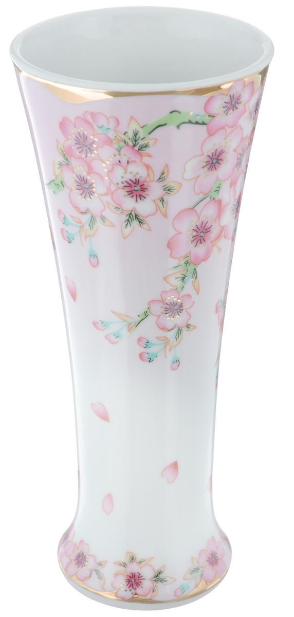 Ваза Elan Gallery Сакура, высота 18 см503518Декоративная ваза Elan Gallery Сакура украсит ваш интерьер и будет прекрасным подарком для ваших близких! Изделие выполнено из высококачественного фарфора и украшено ярким рисунком. Оригинальный дизайн наполнит ваш дом праздничным настроением. Такая ваза станет желанным подарком для ваших близких! Диаметр вазы по верхнему краю: 7,7 см. Диаметр дна: 5,5 см. Высота вазы: 18 см.