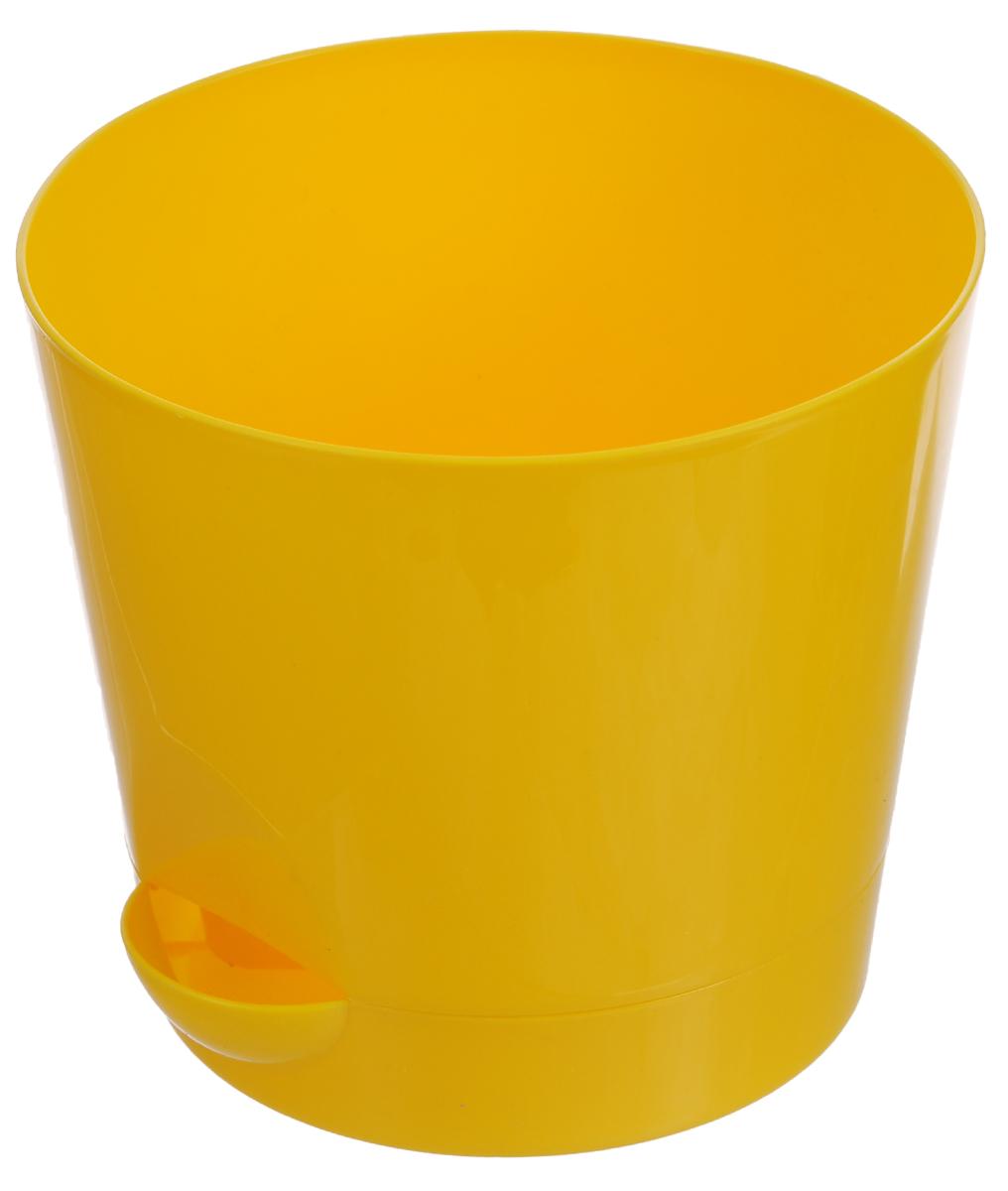 Кашпо Idea Ника, с прикорневым поливом, с поддоном, цвет: желтый, 800 млМ 3071_желтыйКашпо Idea Ника изготовлено из высококачественного полипропилена. В комплект входит поддон со специальной выемкой, благодаря которому имеется возможность прикорневого полива. Изделие подходит для выращивания растений и цветов в домашних условиях. Такое кашпо станет прекрасным дополнением интерьера. Объем горшка: 800 мл. Диаметр горшка (по верхнему краю): 12 см. Высота горшка: 10,7 см. Диаметр поддона: 10 см.
