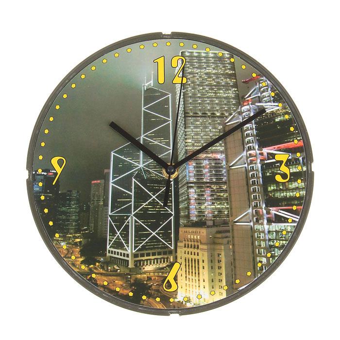 Часы настенные Мегаполис. 729505729505Оригинальные настенные часы Мегаполис круглой формы выполнены из пластика. Часы имеют три стрелки - часовую, минутную и секундную. Циферблат часов защищен пластиком. Необычное дизайнерское решение и качество исполнения придутся по вкусу каждому. Оформите совой дом таким интерьерным аксессуаром или преподнесите его в качестве презента друзьям, и они оценят ваш оригинальный вкус и неординарность подарка. Характеристики: Материал: пластик, металл. Размер: 4 см x 25 см x 25 см. Размер упаковки: 24,5 см х 24,5 см х 4 см. Артикул: 729505. Работают от батарейки типа АА (в комплект не входит).