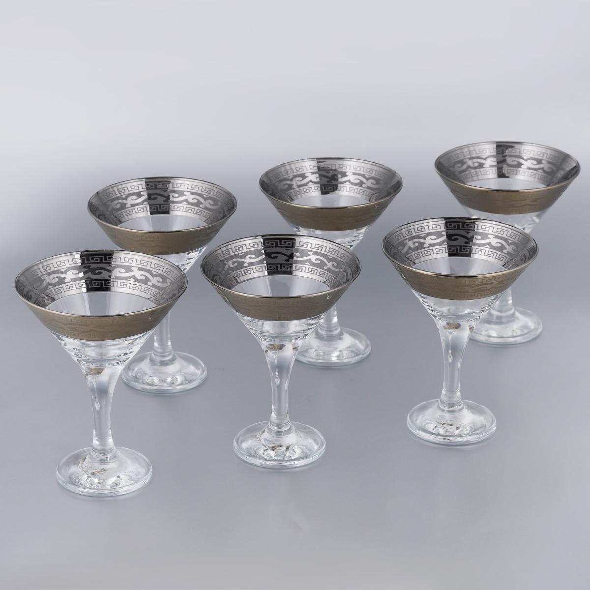 Набор бокалов для мартини Гусь-Хрустальный Версаче, 170 мл, 6 штVT-1520(SR)Набор Гусь-Хрустальный Версаче состоит из 6 бокалов на длинных ножках, изготовленных из высококачественного натрий-кальций-силикатного стекла. Изделия оформлены оригинальной окантовкой и предназначены для подачи мартини. Такой набор прекрасно дополнит праздничный стол и станет желанным подарком в любом доме. Разрешается мыть в посудомоечной машине. Диаметр бокала (по верхнему краю): 10,5 см. Высота бокала: 13,5 см. Диаметр основания бокала: 6,3 см.