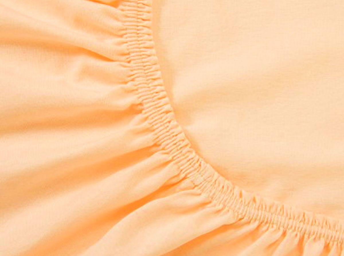 Простыня на резинке Хлопковый Край, цвет: персик, 90 х 200 см90тр-ПнРПростыня на резинке Хлопковый Край, изготовленная из 100% хлопка, будет превосходно смотреться с любыми комплектами белья. Ткань приятная на ощупь, при этом она прочная, хорошо сохраняет форму и легко гладится. Простыня прошита резинкой, что обеспечивает более комфортный отдых, так как она прочно удерживается на матрасе и избавляет от необходимости часто ее поправлять. Простынь подходит для матраса размером 90 х 200 см.